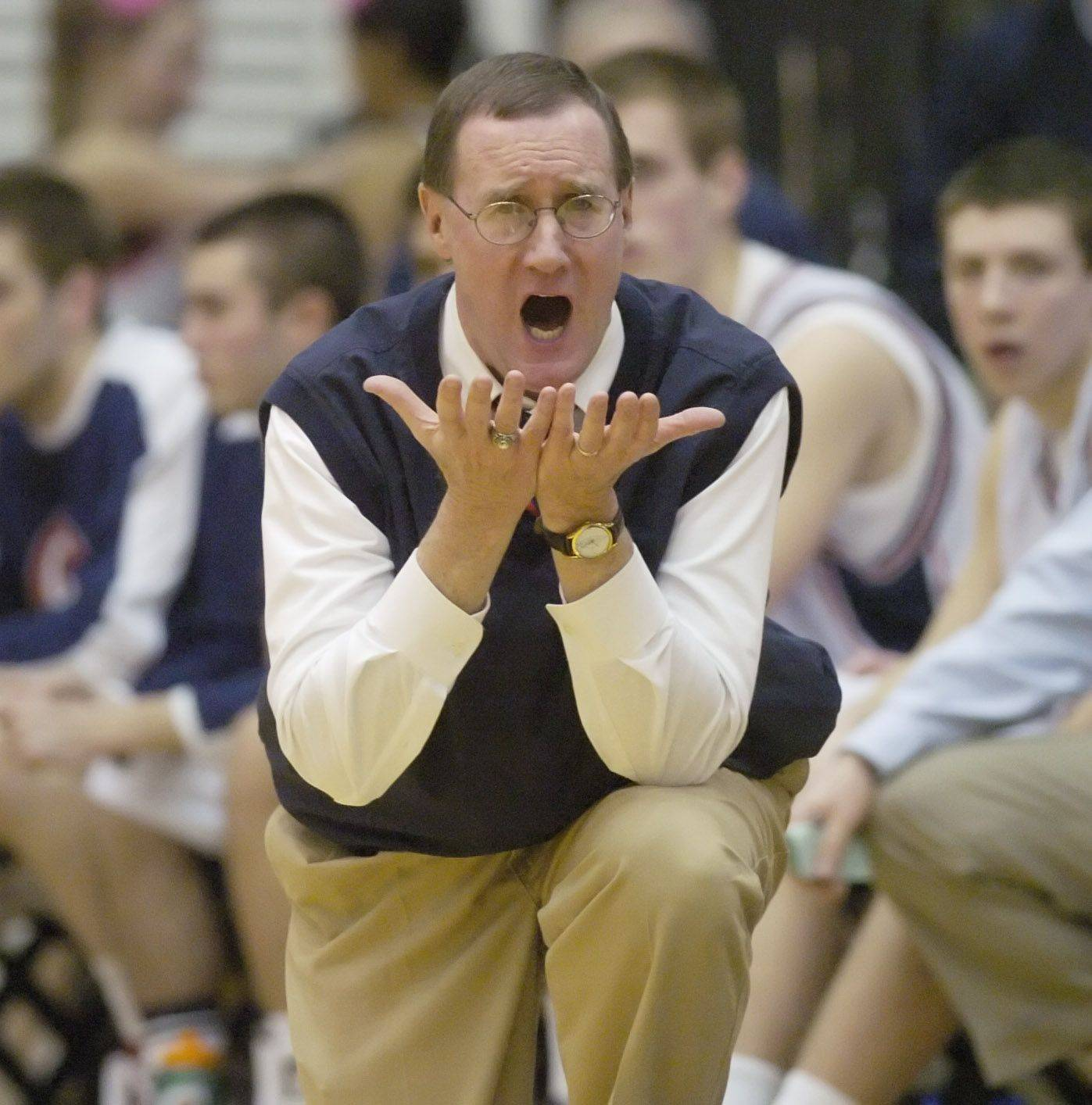 Conant coach Tom McCormack leads his team during Wednesday's regional against St. Patrick.