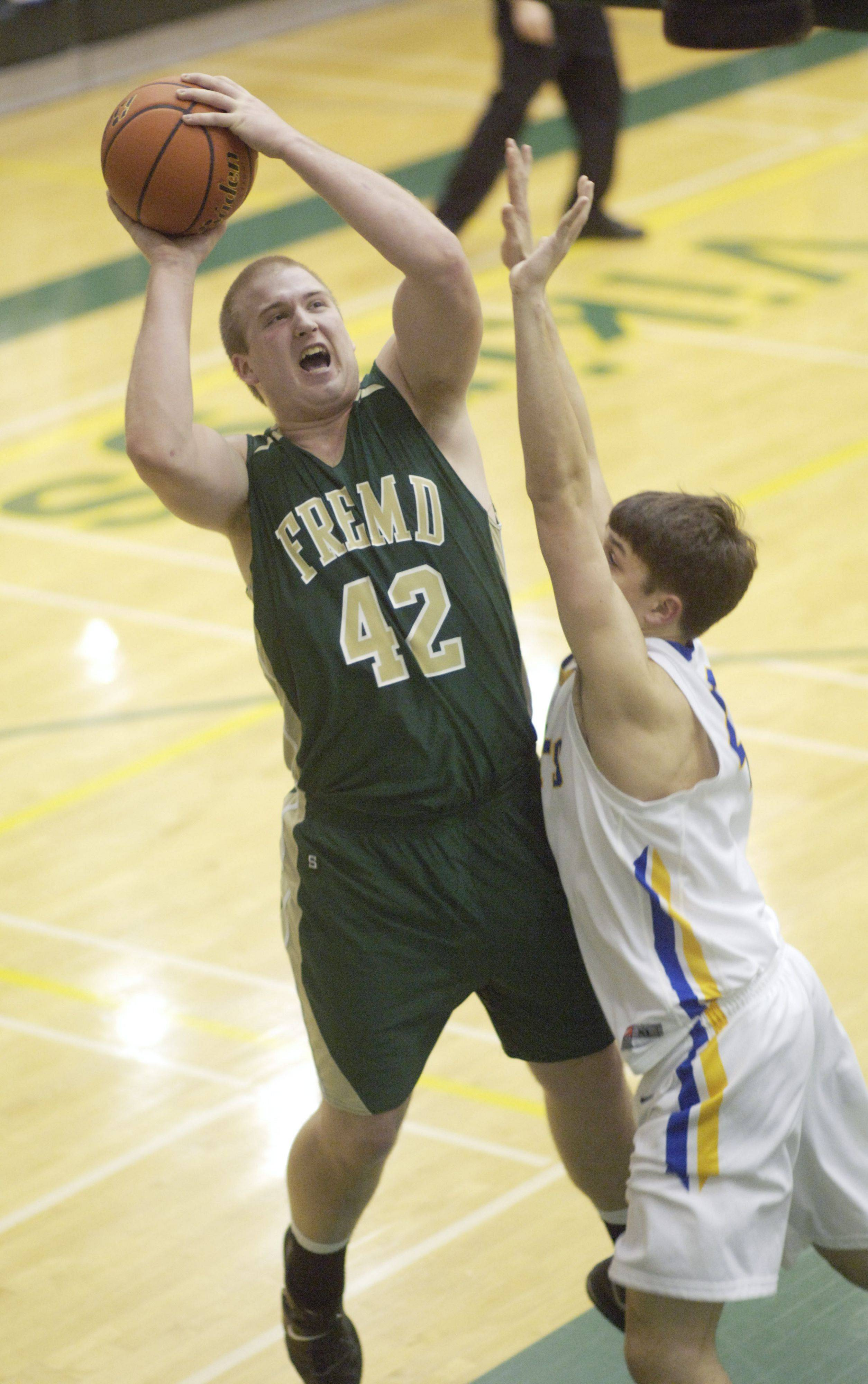 Fremd's Jack Konopka takes a shot in front of Lake Forest's Jonathon Sirus during Friday's game.