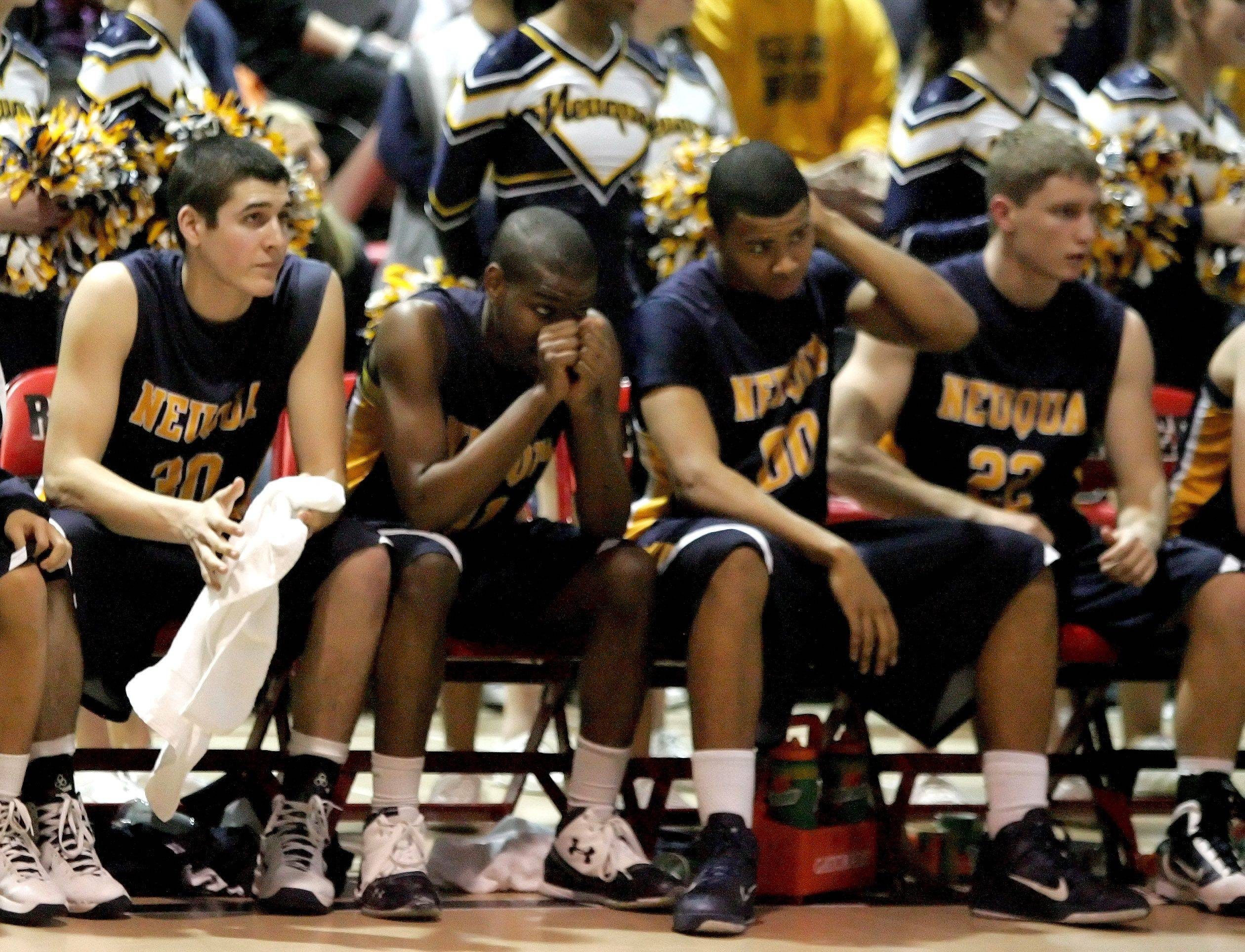 Neuqua Valley bench reacts during their loss to East Aurora at the regional boys basketball championship Friday at Bolingbrook High School.
