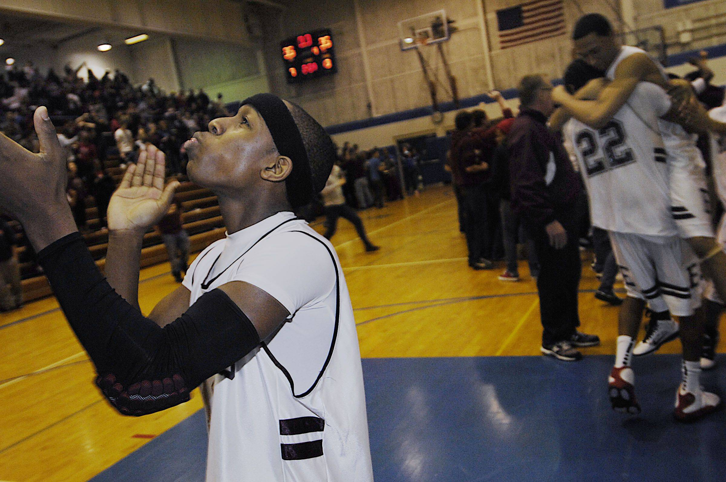 Elgin's Arie Williams and teammates celebrate their win over Dundee-Crown Friday in the 4A Larkin regional championship game.