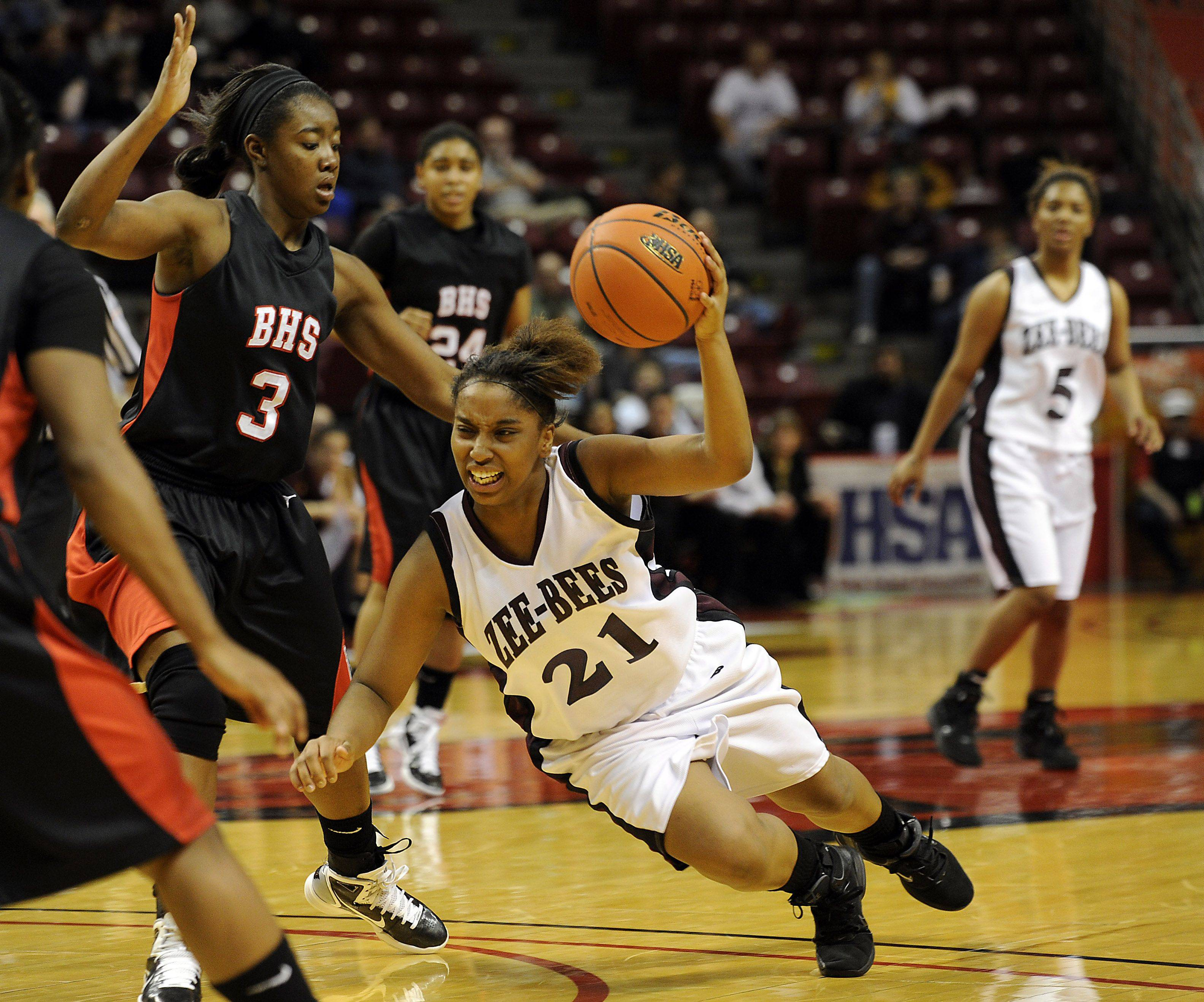 Zion-Benton's Samantha Rodriguez goes down as she drives for the lane as Bolingbrook's Kennedy Cattenhead provide strong defense in the girls Class 4A Girls Basketball Tournament at the Redbird Arena in Normal on Saturday.