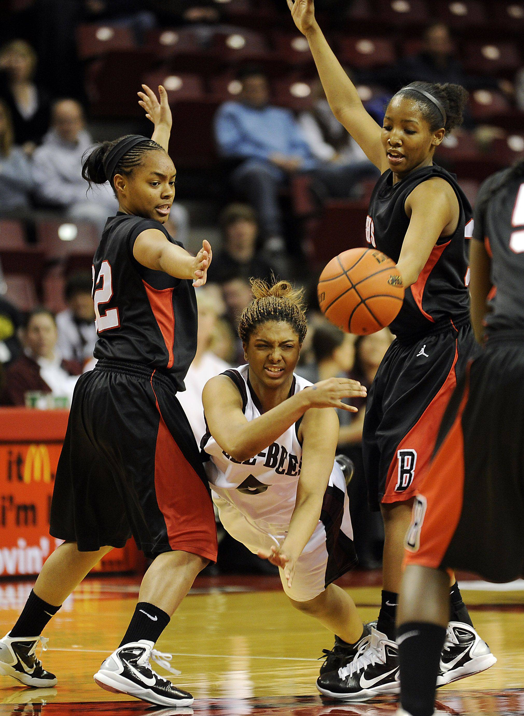 Zion-Benton's Helena Rodriguez drives for the basket but pressure from Bolingbrook's Kierra Ray and Allie Hill forces her to pass the ball in the first half in the girls Class 4A Girls Basketball Tournament at the Redbird Arena in Normal on Saturday.