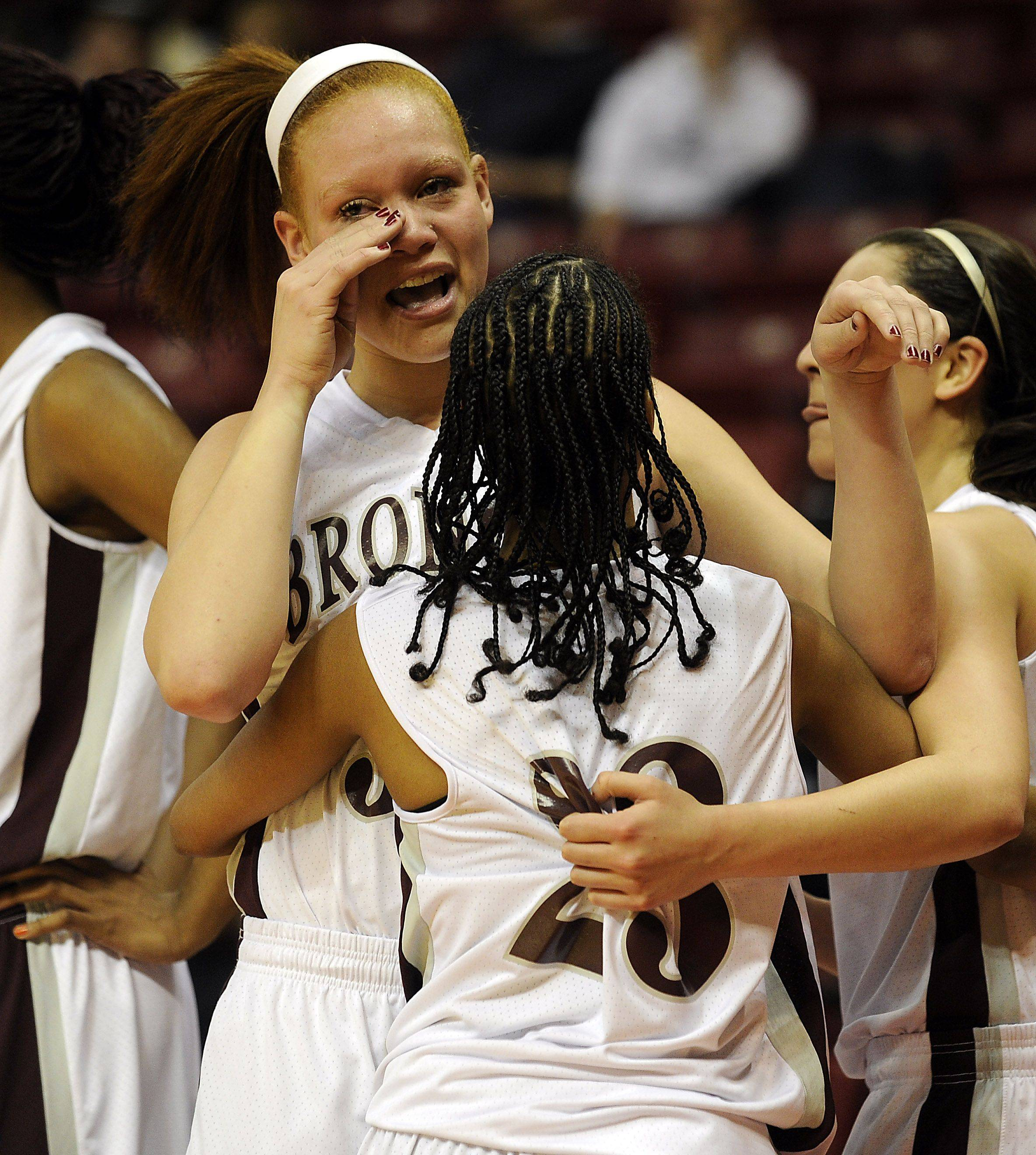 Montini's Whitney Adams cries tears of joy as she hugs her teammate Kiki Wilson after their victory over Hillcrest in the girls Class 3A basketball action at Redbird Arena on Saturday.