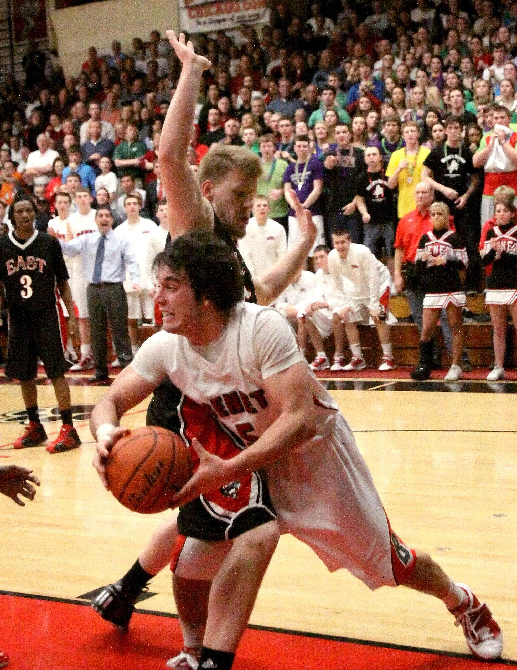 Pat Boyle of Benet Academy moves past Tom Okapal of East Aurora.