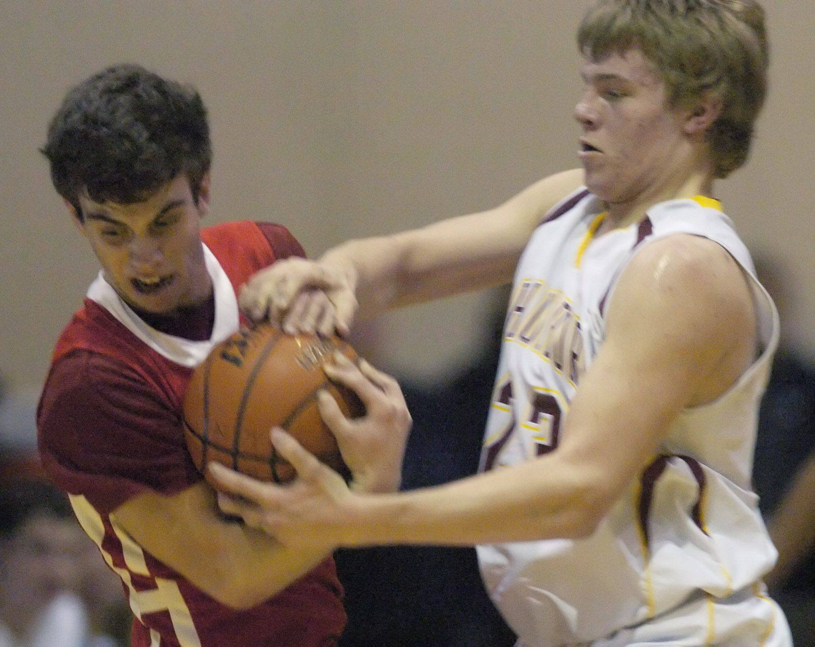 Schaumburg's Kyle Bolger, right, tries to grab the ball from Niles West's Nathan Sagett.