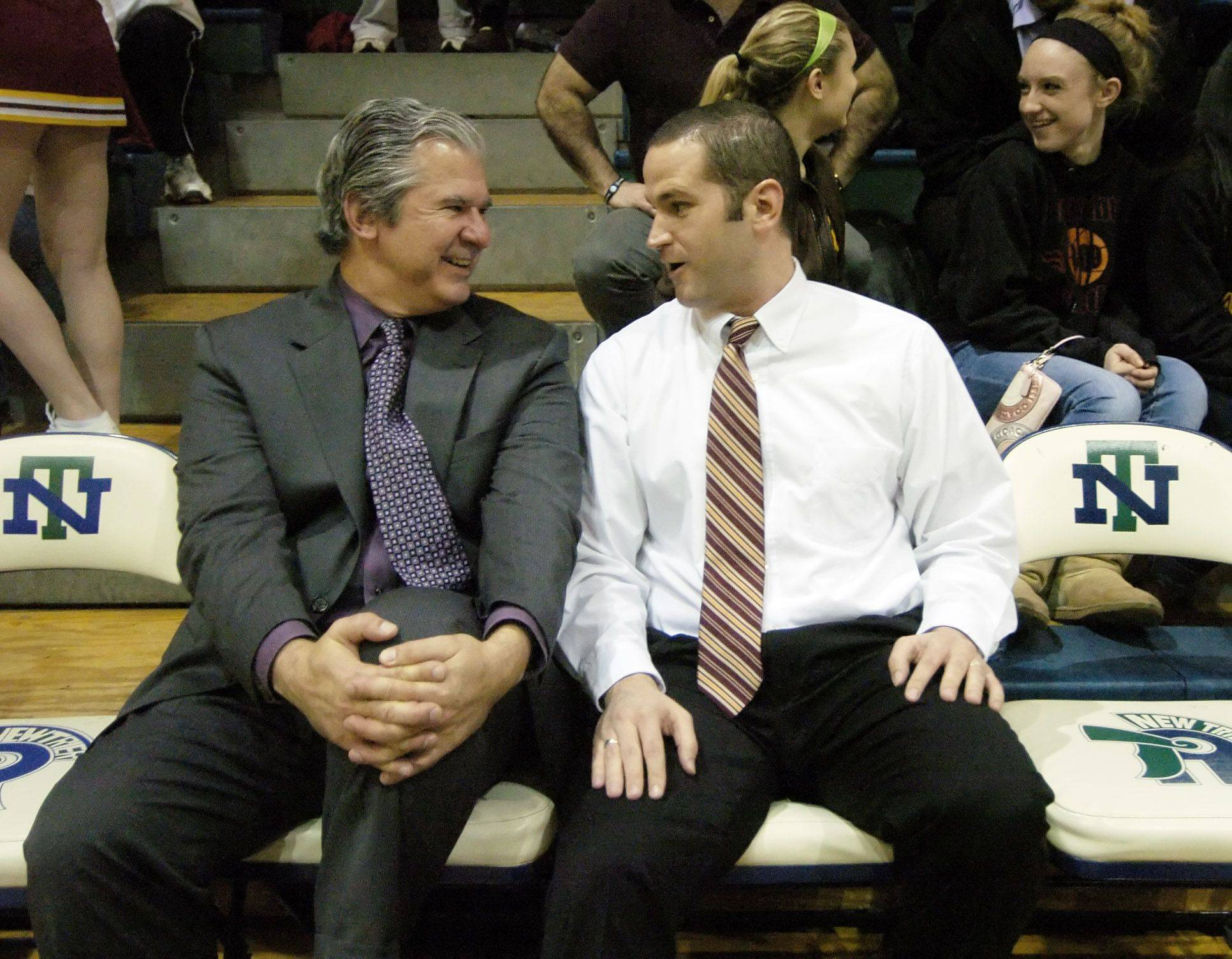 Niles West coach Bob Williams, formerly the head coach of the Schaumburg boys basketball team, talks with current Schaumburg coach Matt Walsh .