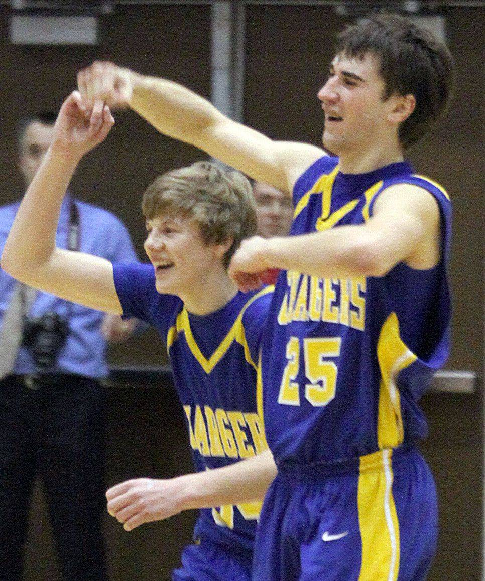 Aurora Central Catholic's Ryan Harreld, left, and Joey Mceachern celebrate a victory over Marian Central .