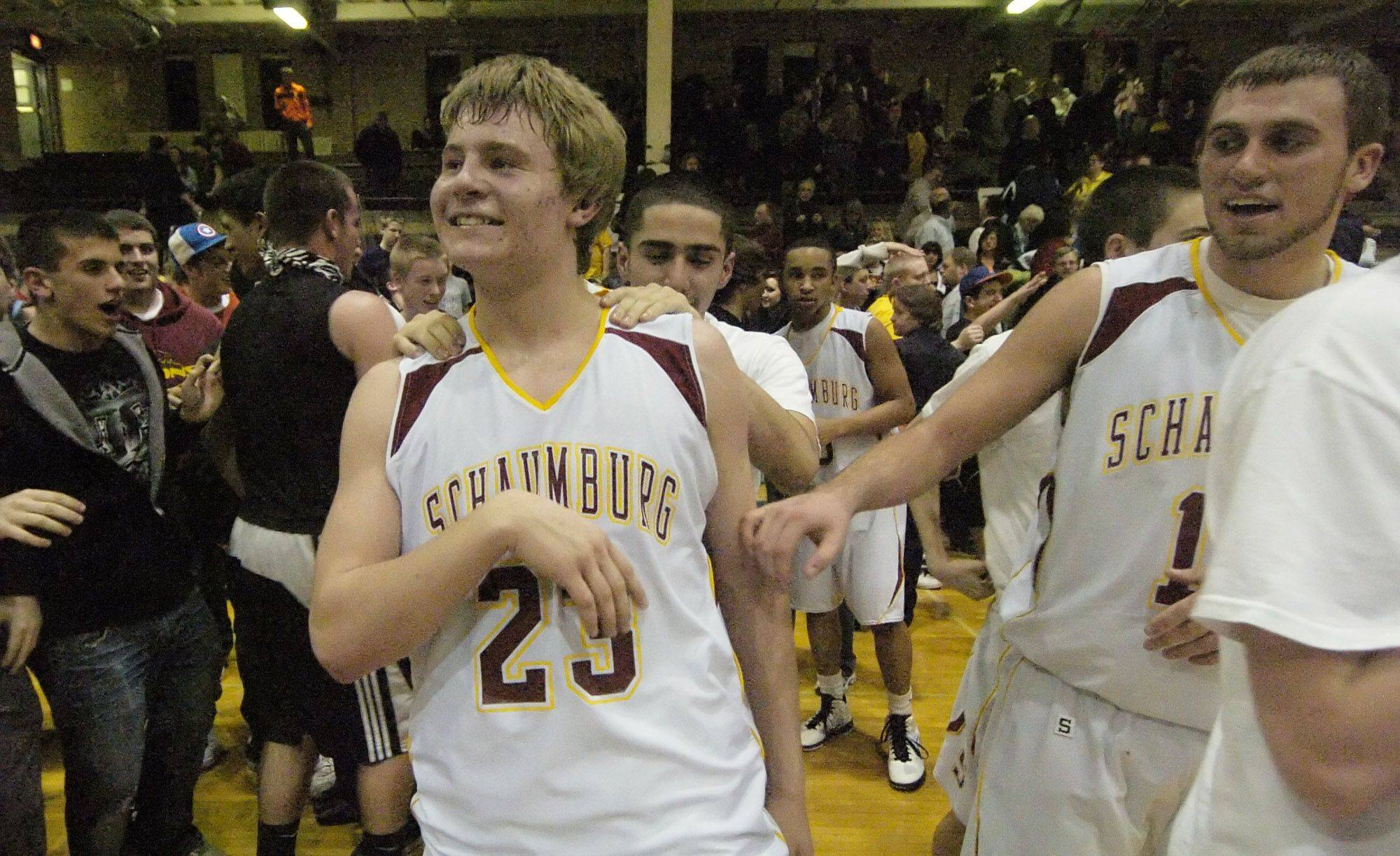 Schaumburg's Kyle Bolger, left, and teammate Christian Spandiary celebrate their team's victory over Niles West during Wednesday's sectional semifinal at New Trier.