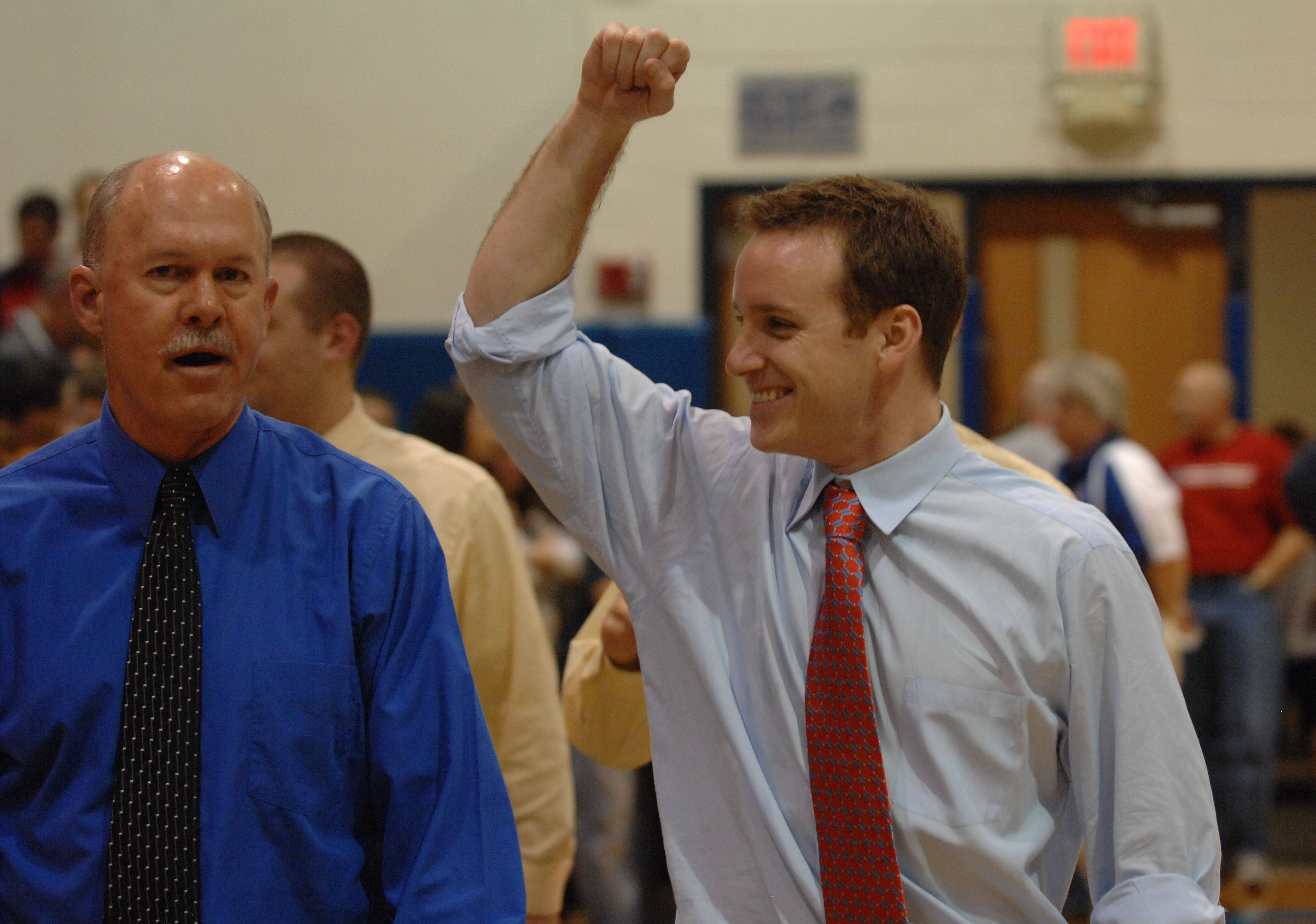 St. Viator boys basketball assistant coach and former star guard Mike Howland, right, has been named the program's new head coach. Howland replaces Joe Majkowski, left, who retired after 24 years in early April.