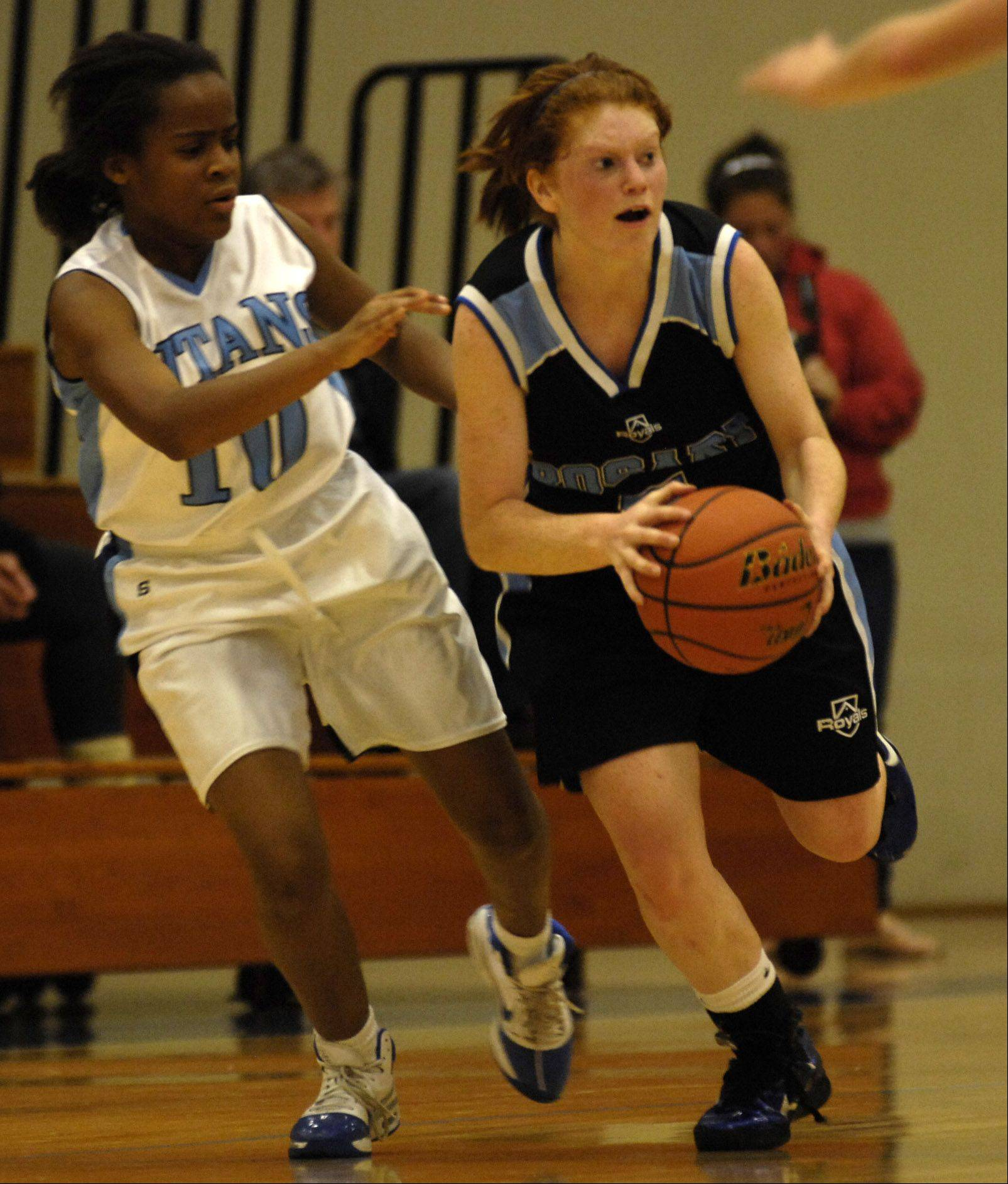 IMSA's Kendall Byrd defends Rosary's Courtney Bila Monday during their game at IMSA.