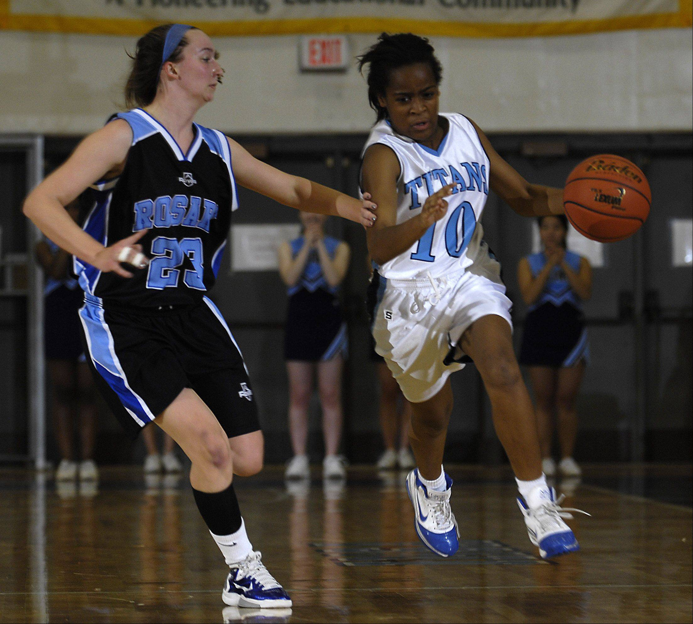 Rosary's Mary Wentworth guards IMSA's Kendall Byrd Monday during their game at IMSA.
