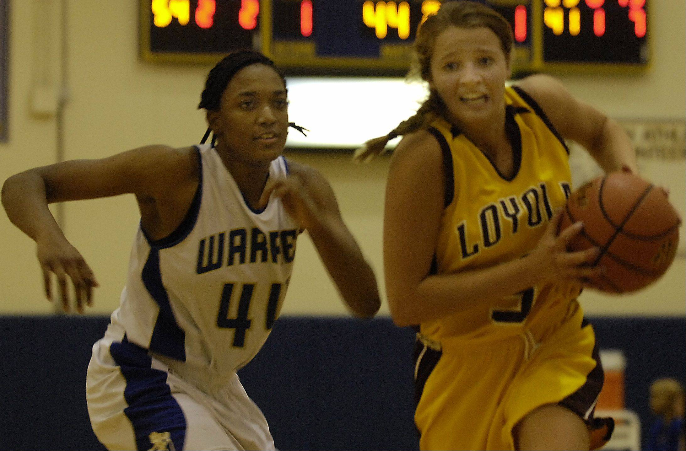 Warren's Alyssa Phillips Loyola's Lauren Kritz Wednesday during their game at Warren Township. Loyola won the game despite a late fourth quarter push by Warren.