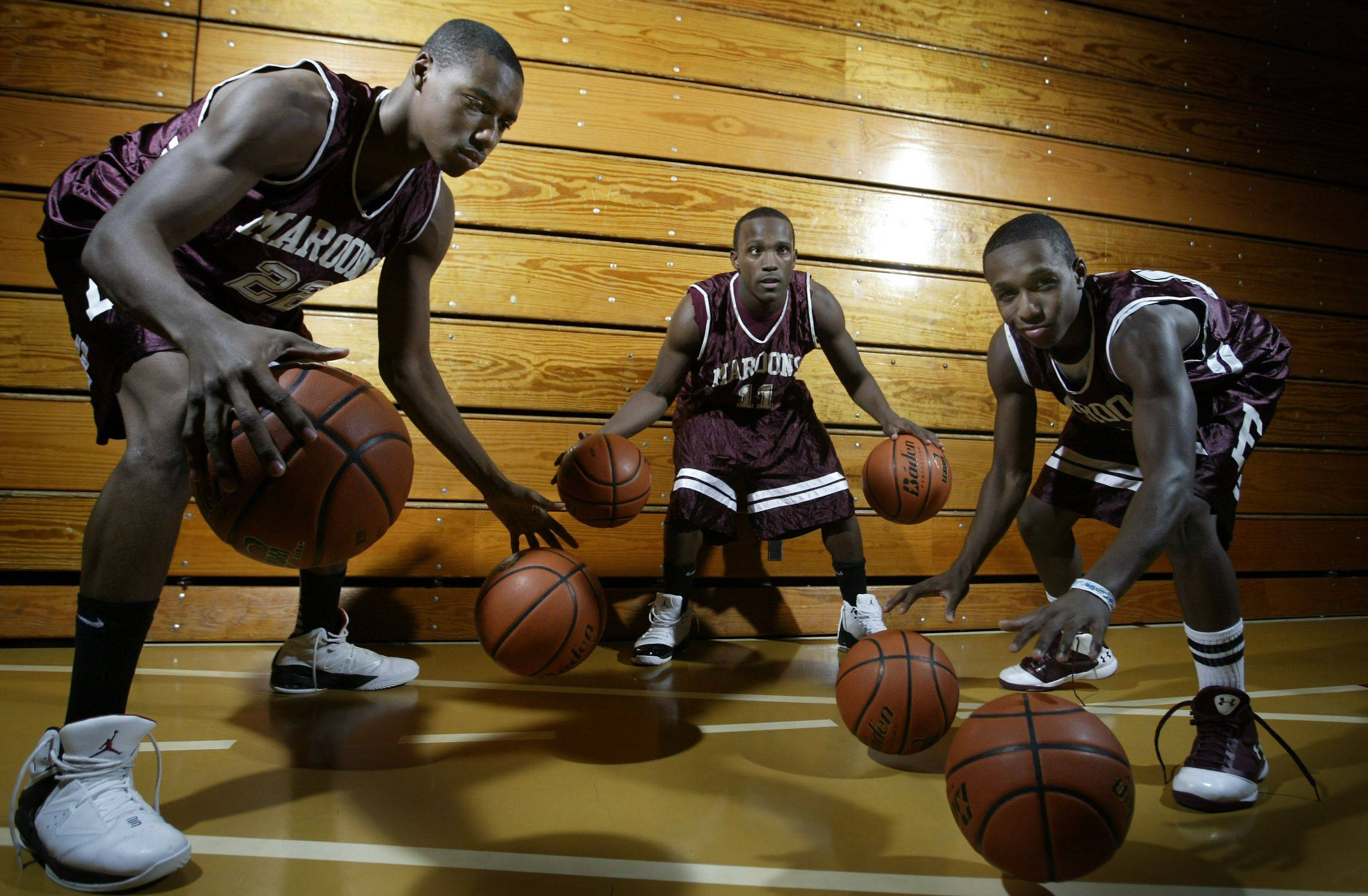 Kory Brown, left, Dennis Moore and Arie Williams will lead Elgin into the 2011-12 boys basketball season.
