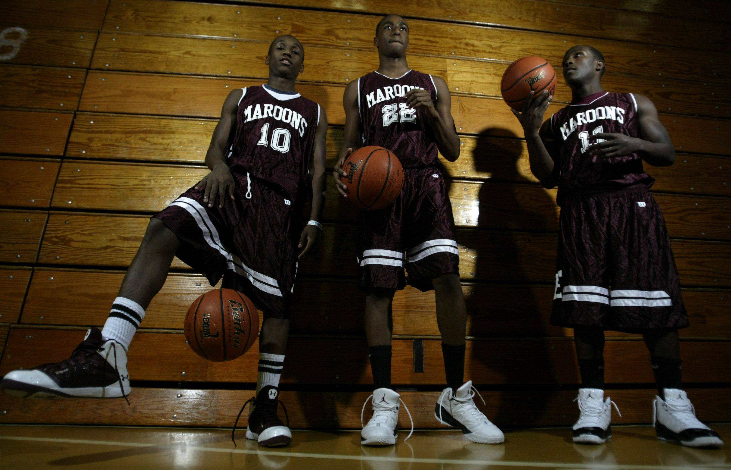 Arie Williams (10), Kory Brown (22), and Dennis Moore (11), will lead Elgin into the boys basketball season.