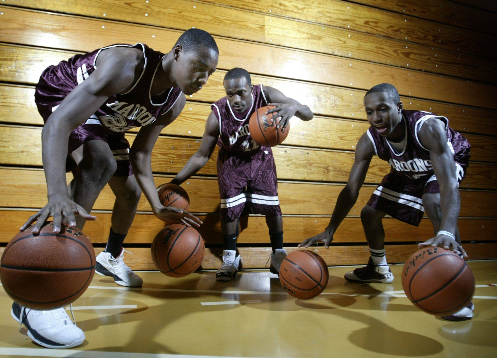 Kory Brown, left, Dennis Moore and Arie Williams will lead Elgin into the boys basketball season.