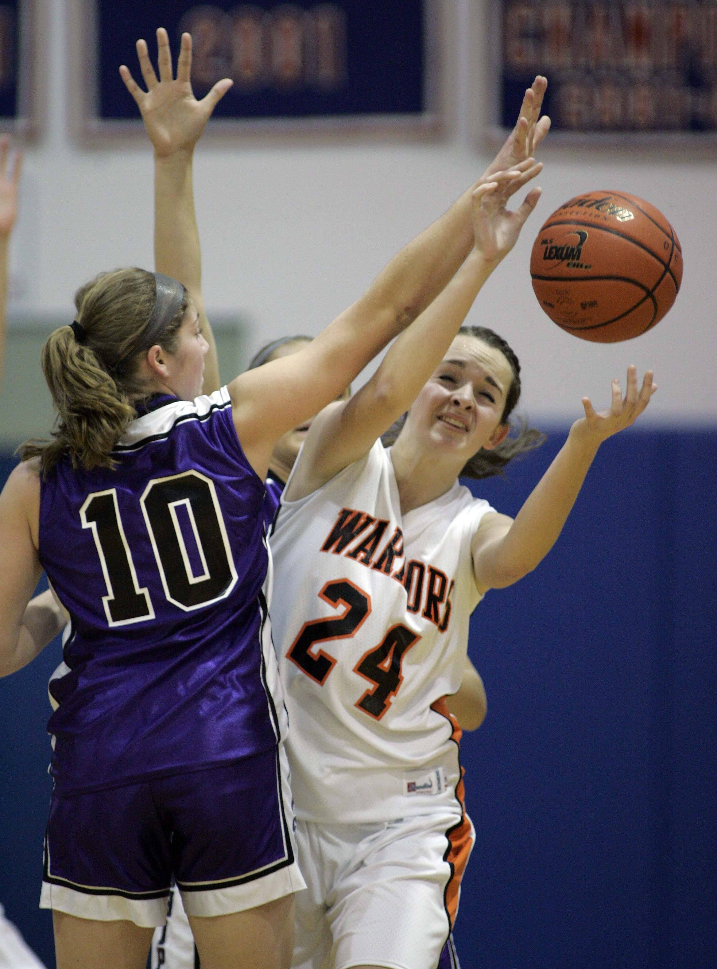 Hampshire's Jennifer Dumoulin (10) puts the pressure on McHenry center Katie Hennelly (24) during Hampshire vs McHenry girls basketball at the Dundee-Crown tournament Saturday, November 19, 2011 in Carpentersville.