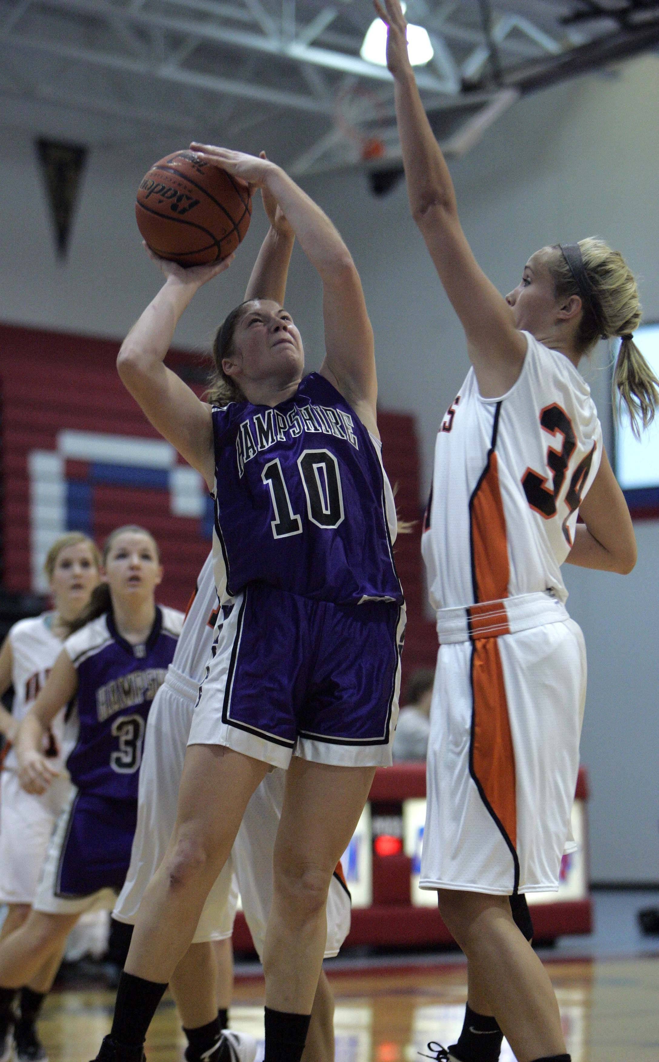 Hampshire's Jennifer Dumoulin (10) puts up a shot against McHenry center Meghan Martell (34) during Hampshire vs McHenry girls basketball at the Dundee-Crown tournament Saturday, November 19, 2011 in Carpentersville.