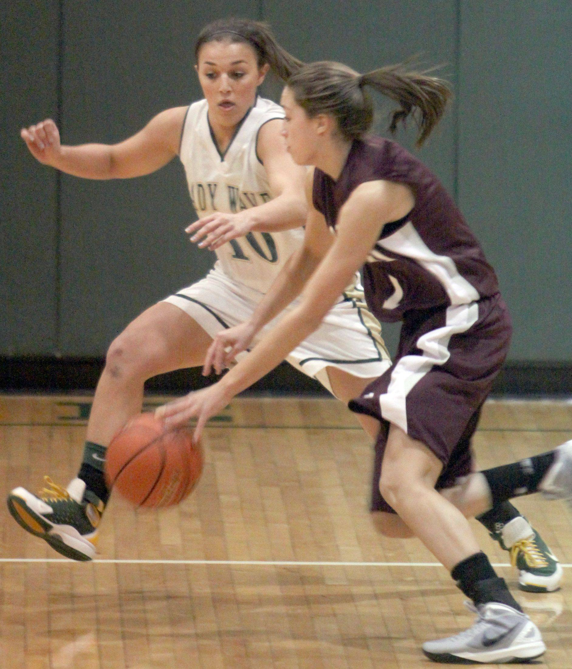 St. Edward's Callie Johnson, left, tries to contain Montini's Kelsey Bogdan, right.