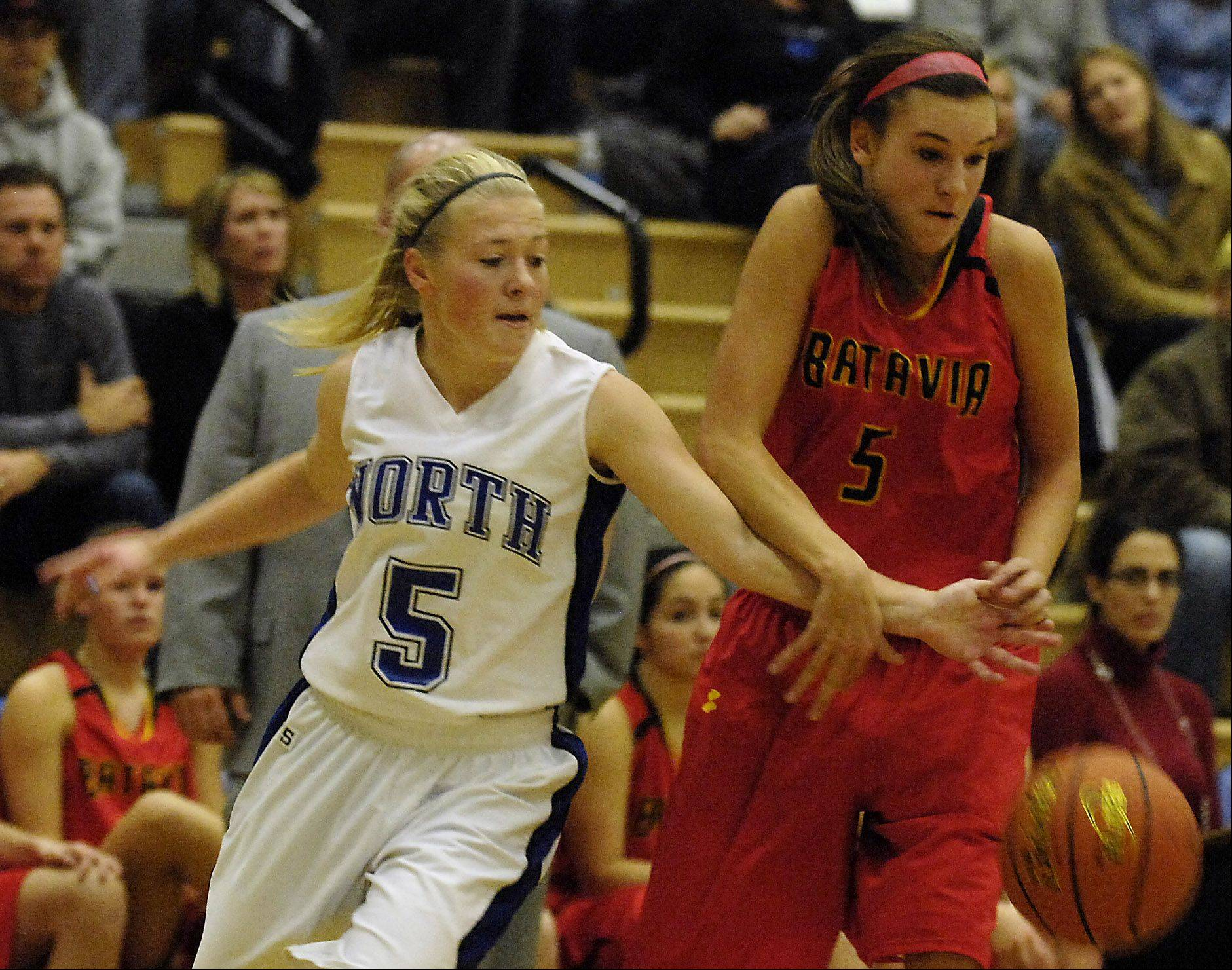 St. Charles North's Natalie Winkates tries to steal the ball from Batavia's Liza Fruendt.