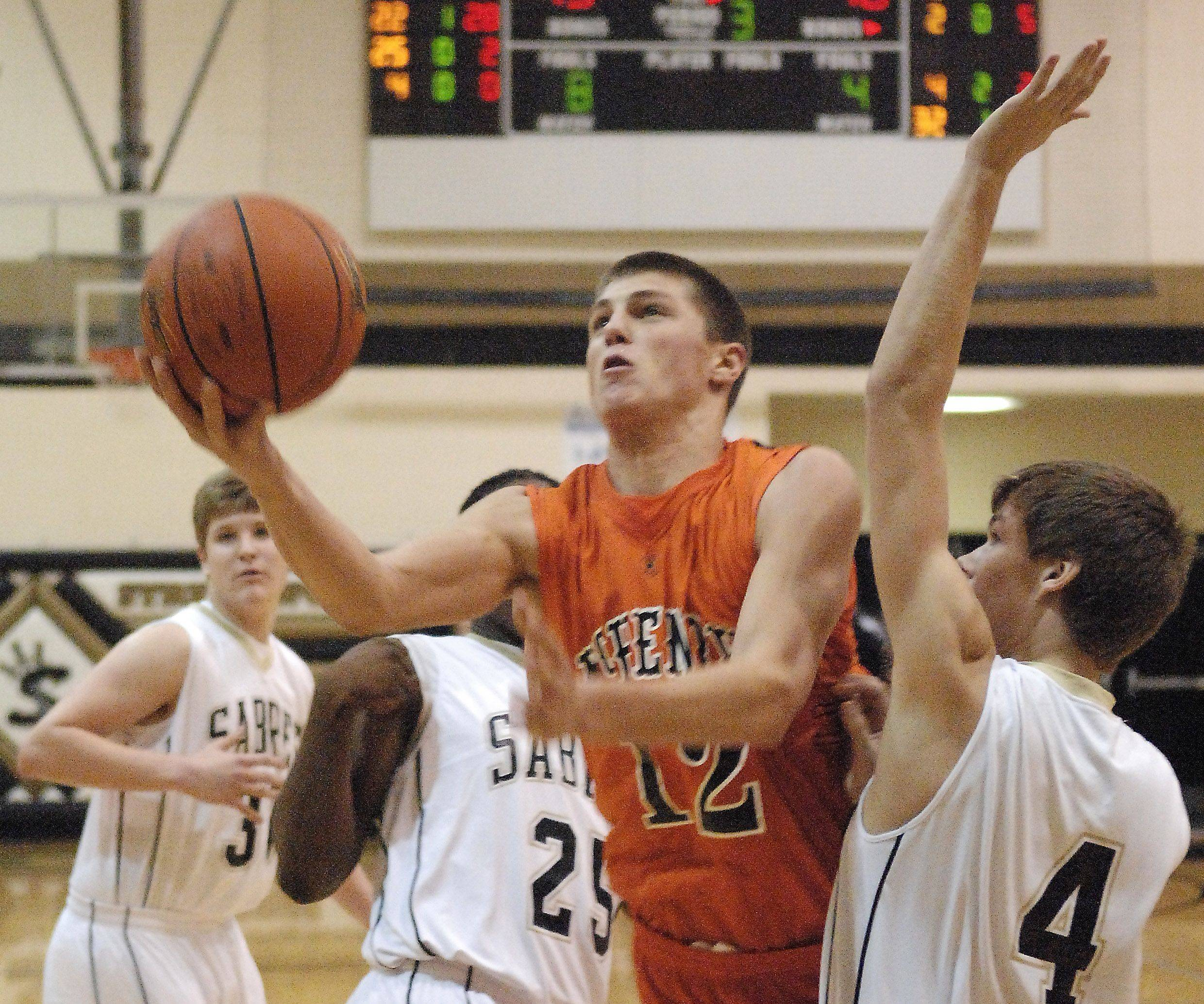 McHenry's Robert Tonyan drives and scores between three Streamwood defenders during Thursday's game at Streamwood.