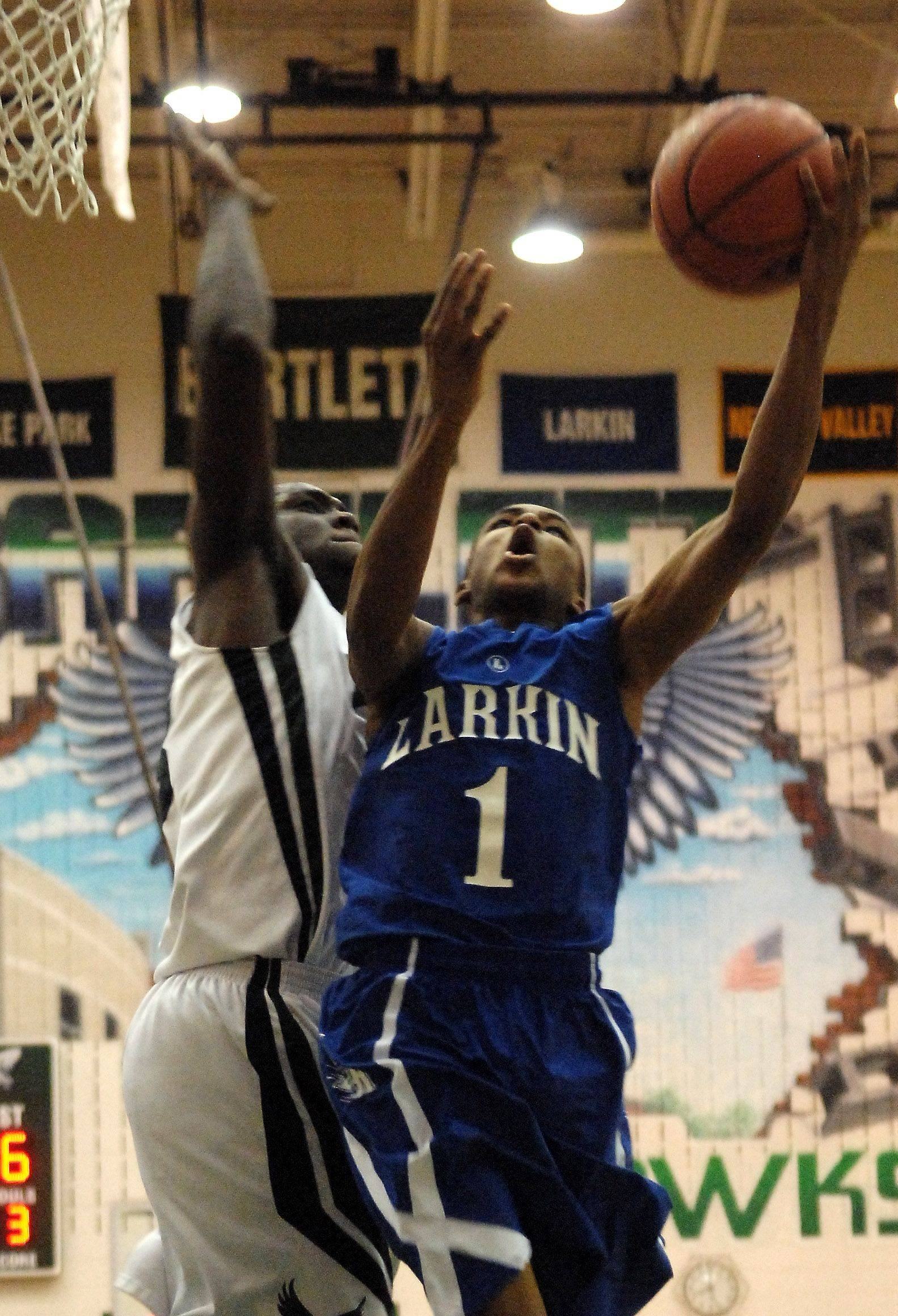 Larkin's Quantice Hunter drives for a layup against Bartlett's Lorenzo Mitchell during Friday's game at Bartlett. Hunter has helped the Royals to a 5-0 start to the season.
