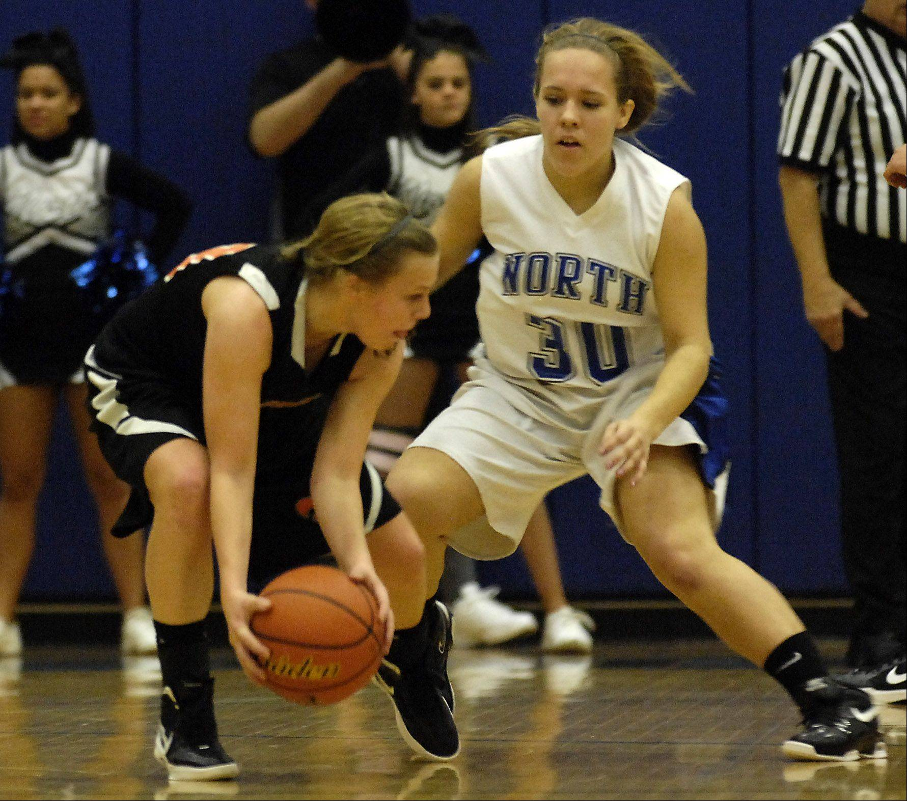 St. Charles East's Amanda Hilton tries to keep the ball from St. Charles North's Ava Tarka during their game Wednesday in St. Charles.