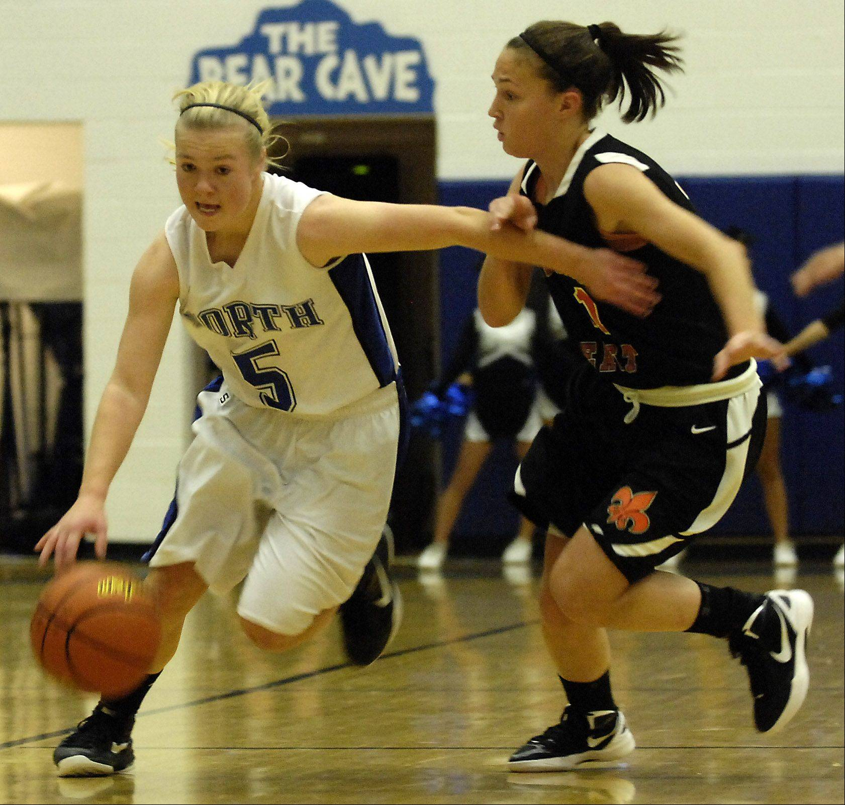 St. Charles North's Natalie Winkates drives past St. Charles East's Carly Pottle during their game Wednesday in St. Charles.