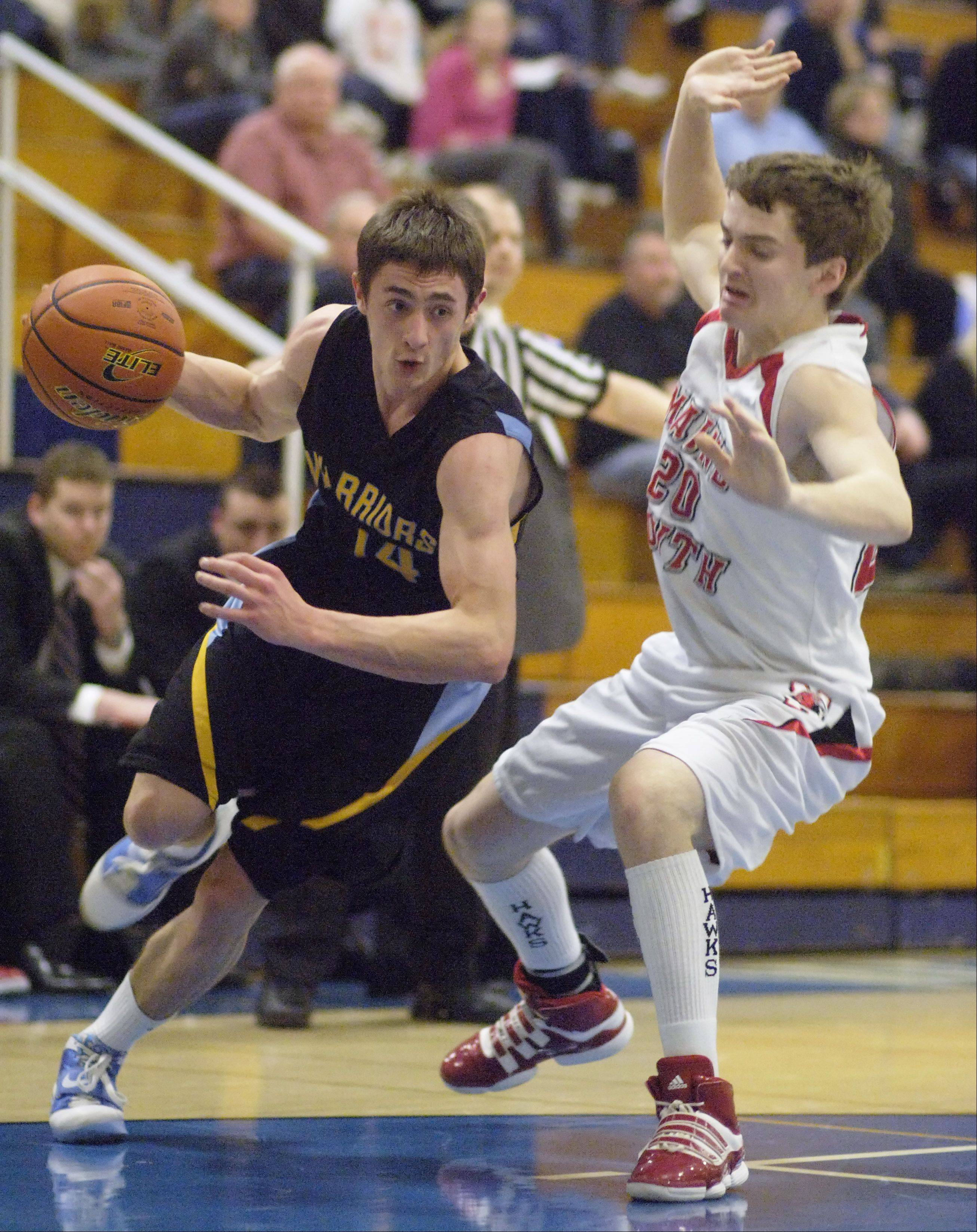 Maine West's Conor Hart, here driving against Maine South's Alex Sir last season, is among the players to watch at Wheeling's Wildcat Hardwood Classic.