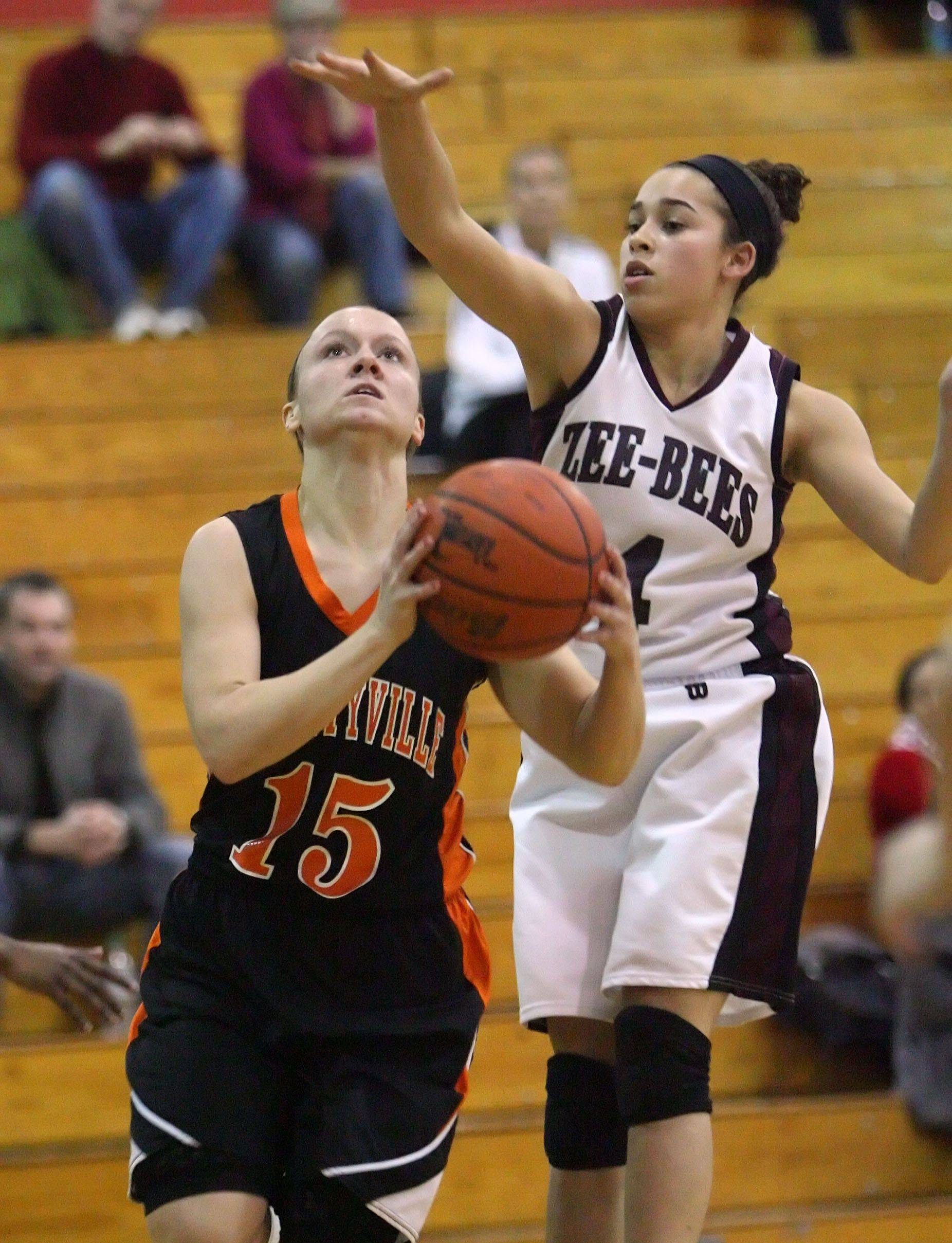 Libertyville's Alex Haley, left, drives on Zion-Benton's Morgan Franklin on Wednesday night.