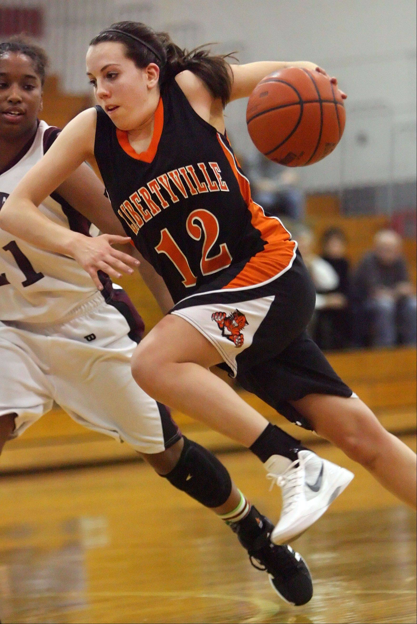 Libertyville's Olivia Mayer, right, drives on Zion-Benton's Samantha Rodriguez.