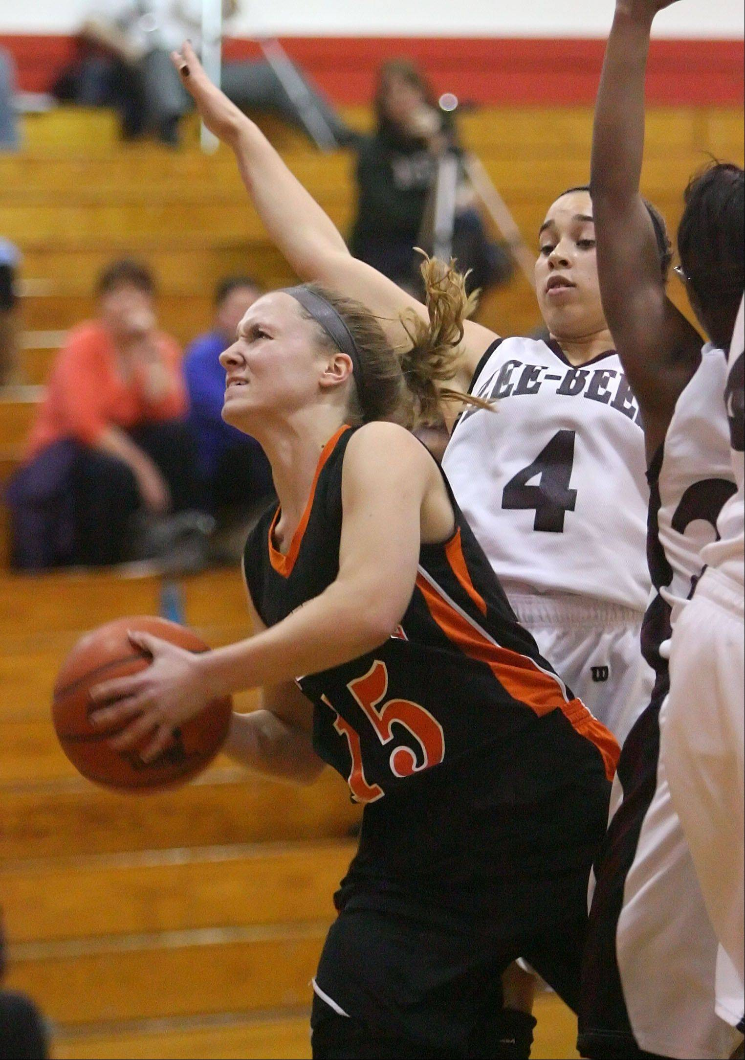 Libertyville's Alex Haley, left, drives on Zion-Benton's Morgan Franklin .