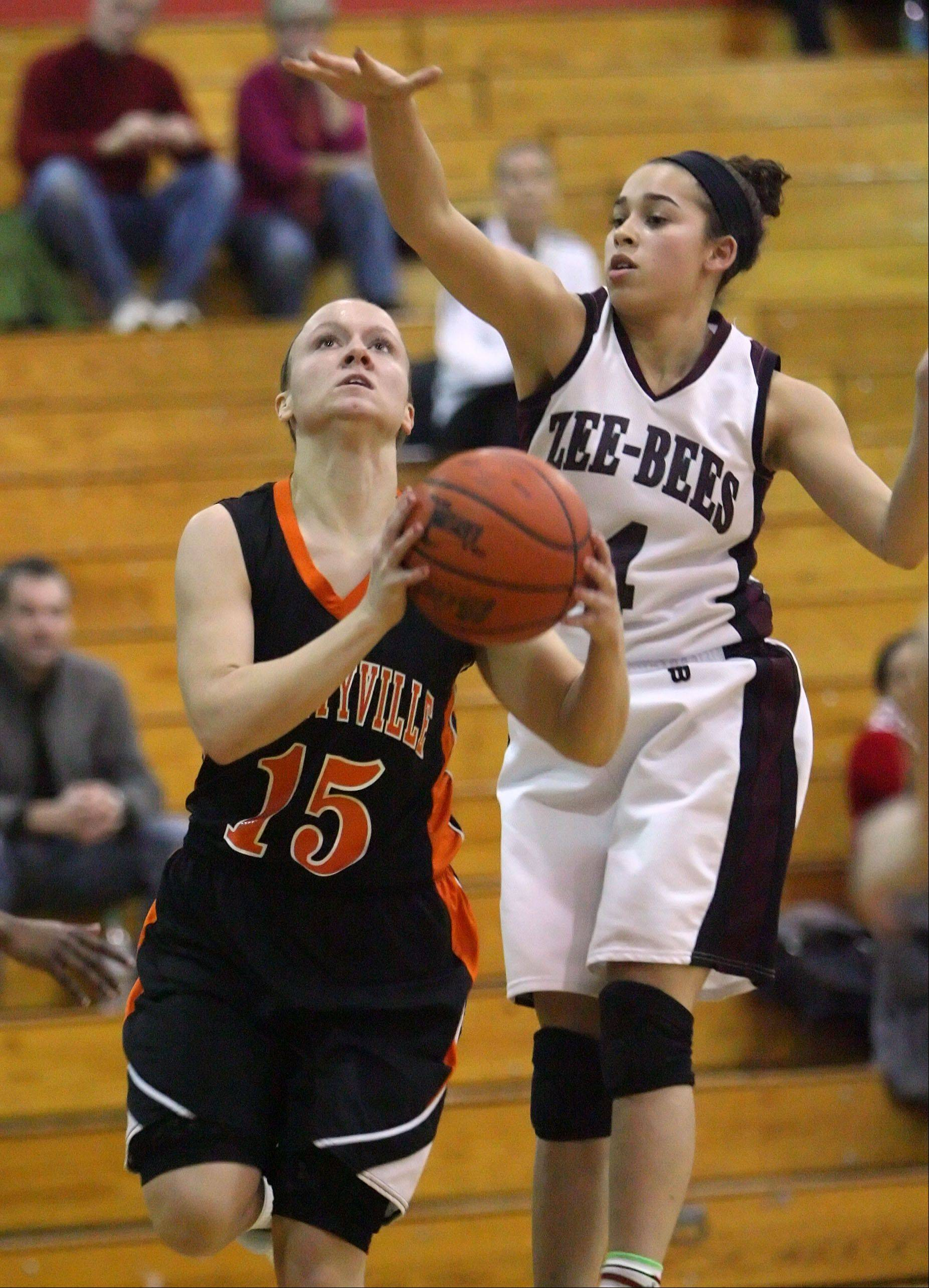 Libertyville's Alex Haley, left, drives on Zion-Benton's Morgan Franklin.