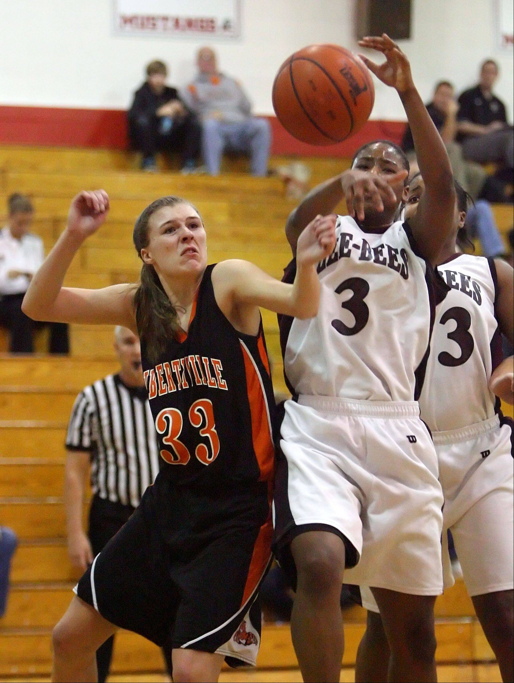 Libertyville's Haley Hoeksel, left, and Zion-Benton's Octavia Crump battle for a rebound.