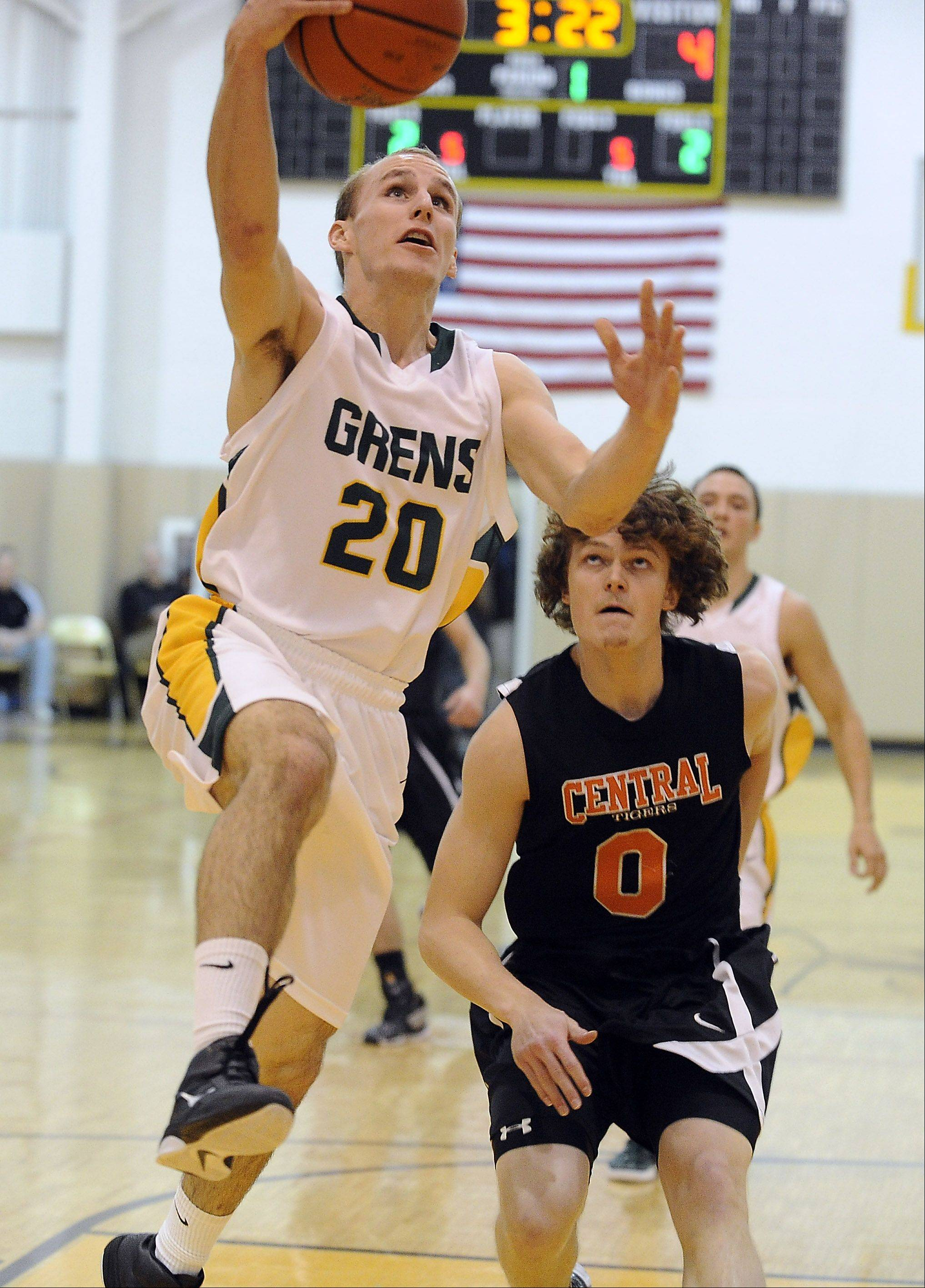 Crystal Lake Central's Nick Decoster is unable to stop Elk Grove's Jeff Miceli in the first quarter as he drives to the basket in Jacobs tournament semifinal play Thursday.