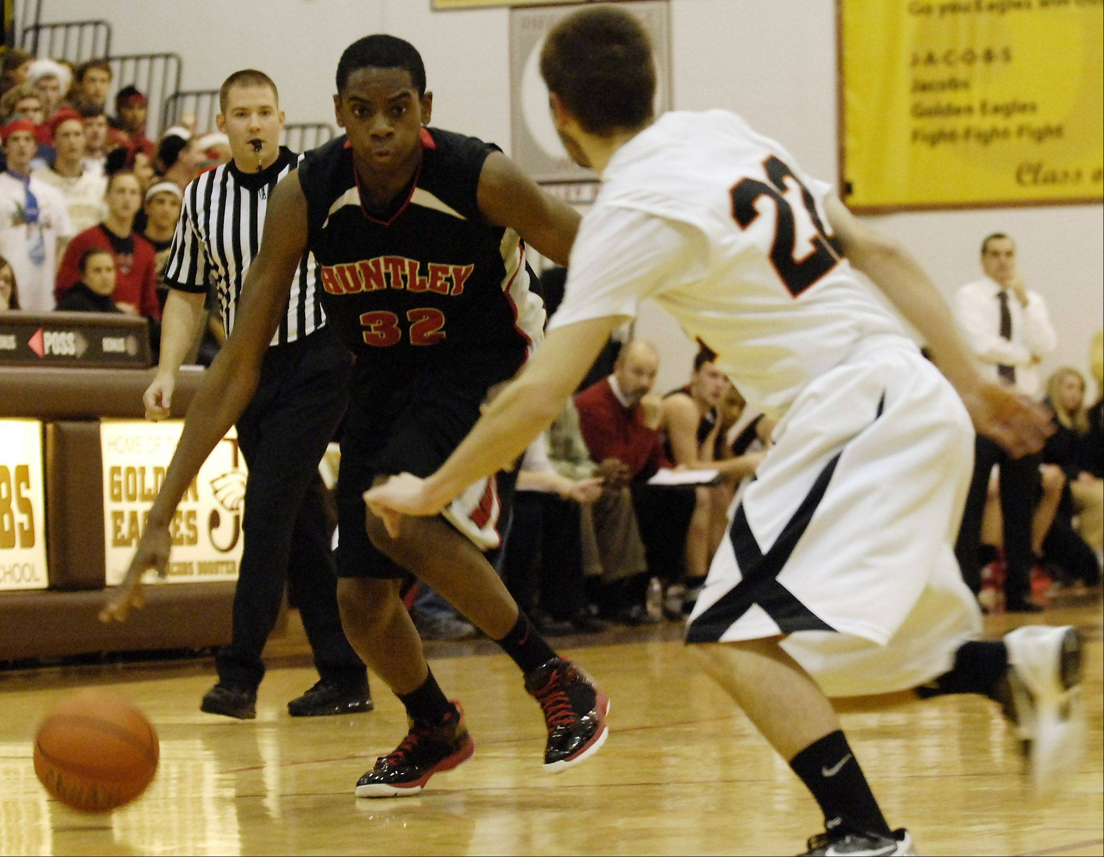 Huntley's Amanze Egekeze drives to the basket against Crystal Lake Central's Brad Knoeppel.