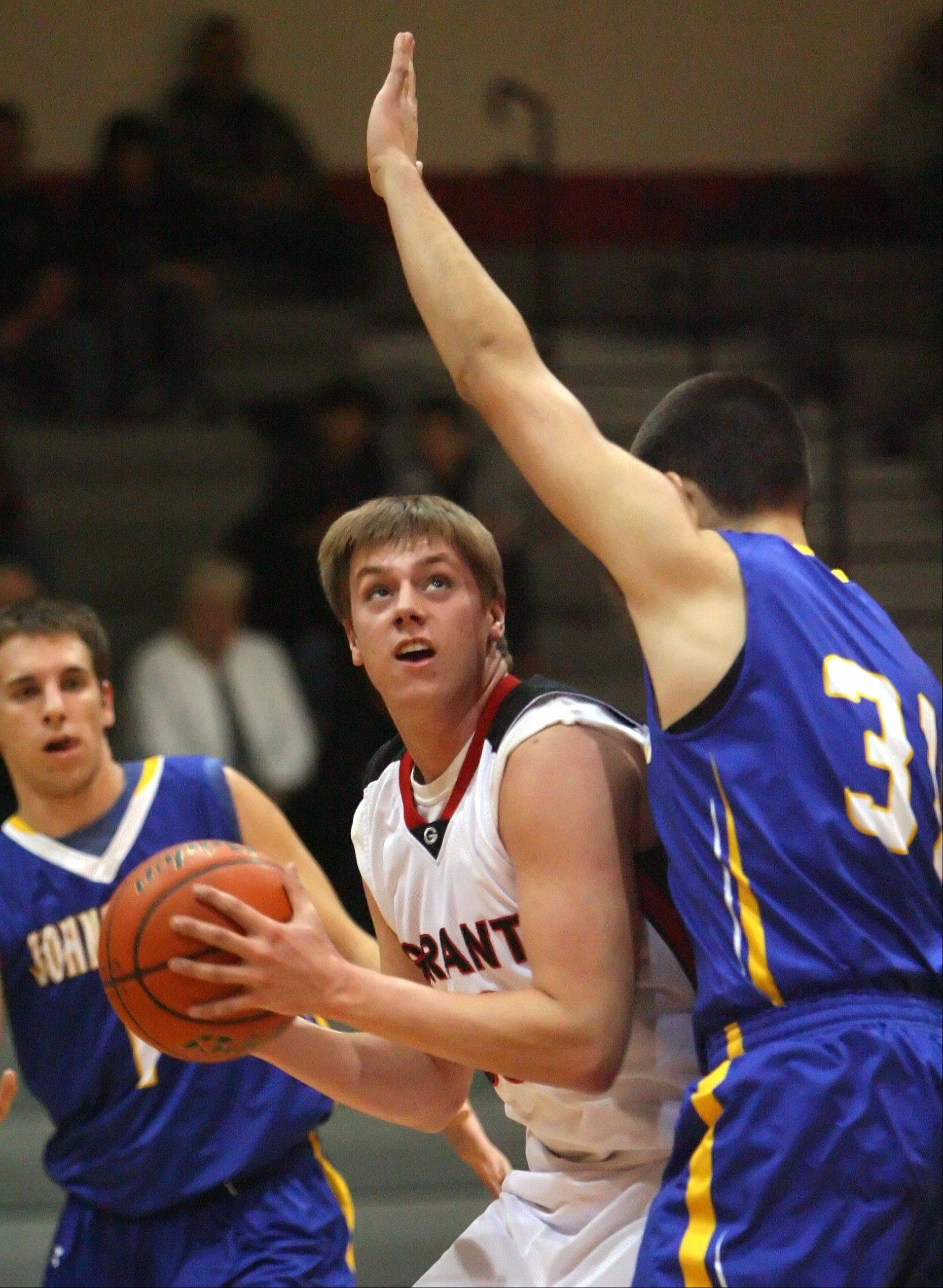 Grant's Jared Helmich, left, drives on Johnsburg's Marcus Huemann on Wednesday night at Grant.