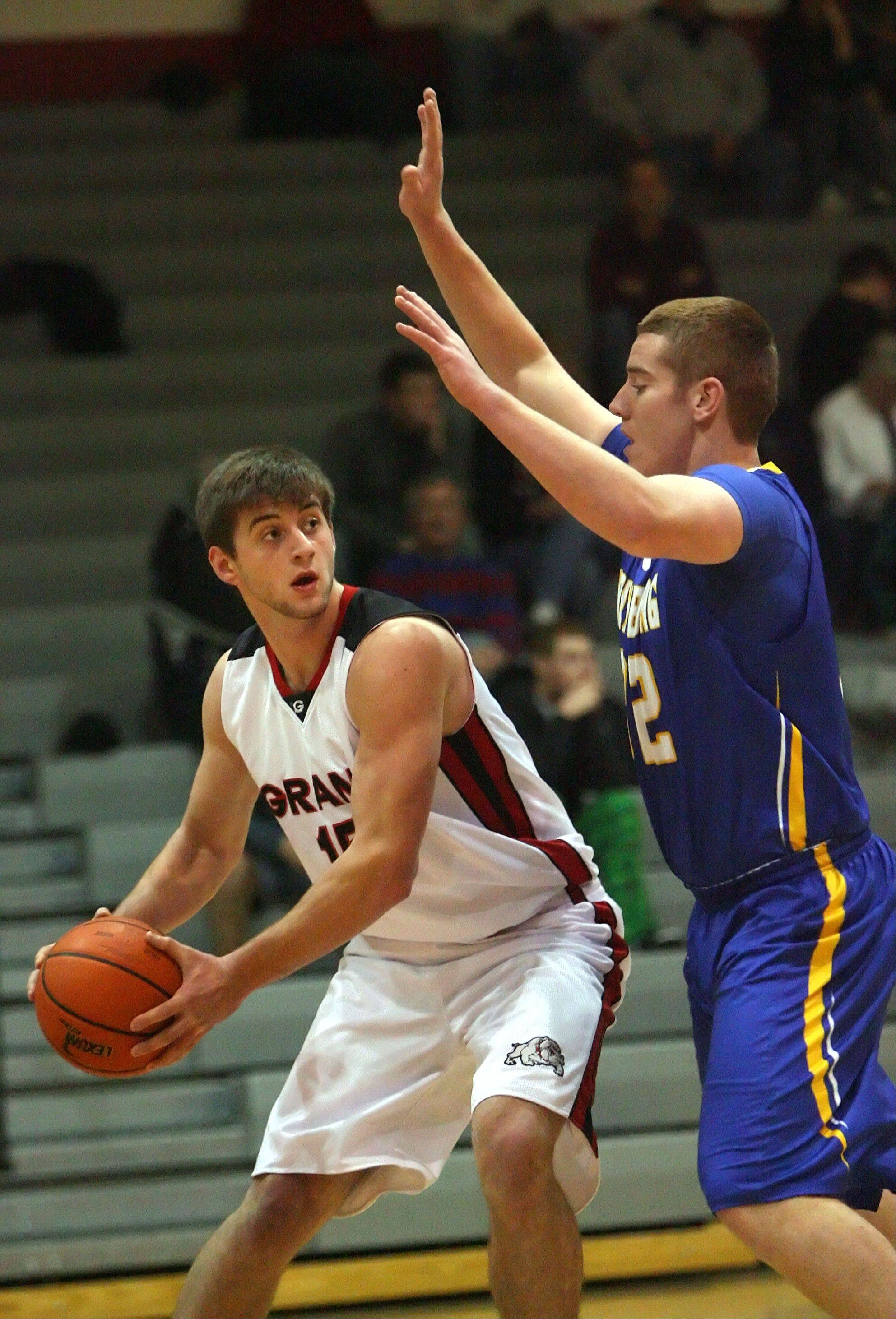 Grant's Ilya Kadushin, left, looks to pass around Johnsburg's Michael Conroy on Wednesday night at Grant.
