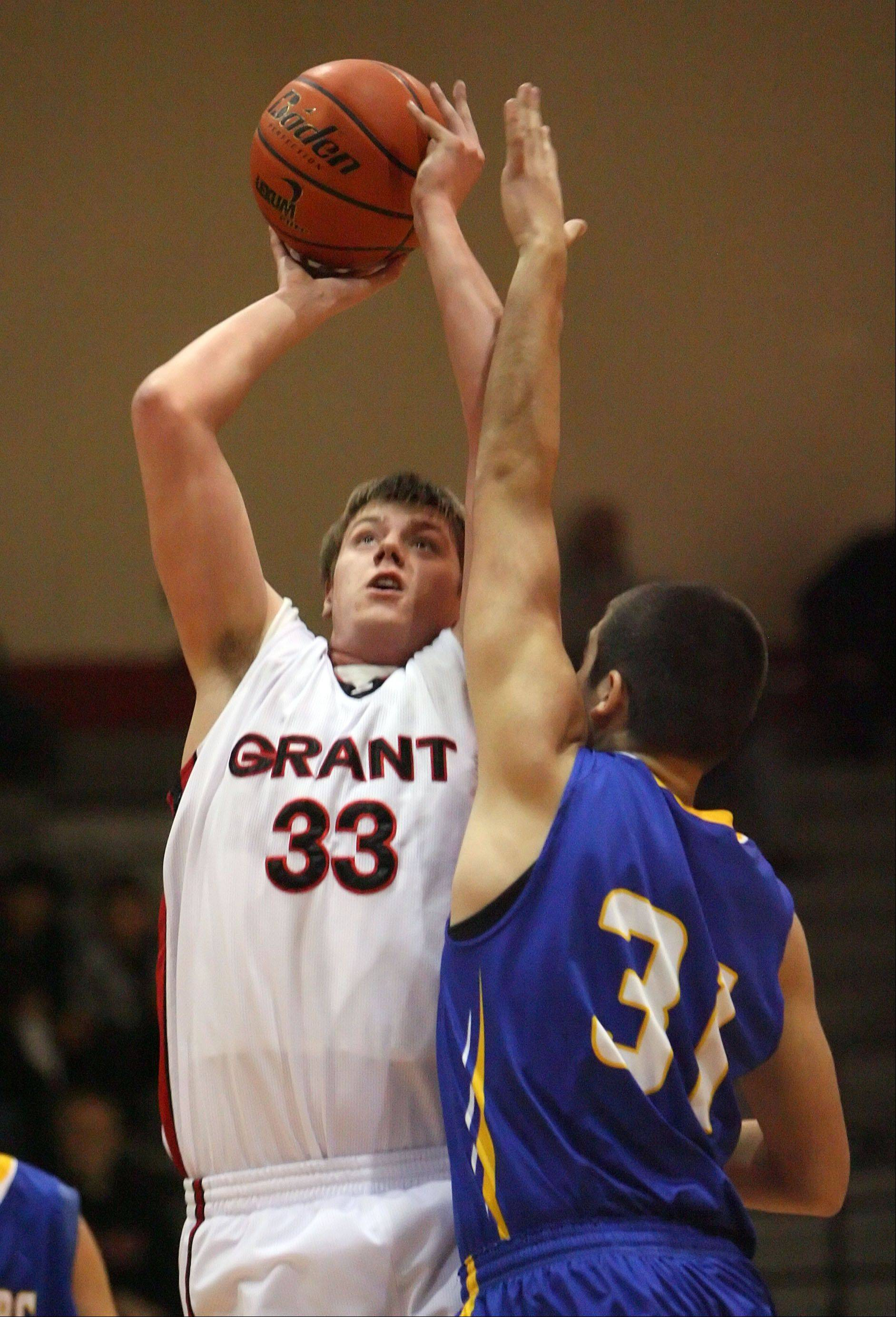 Grant's Jared Helmich shoots over Johnsburg's Marcus Huemann during their game Wednesday night at Grant High School in Fox Lake.
