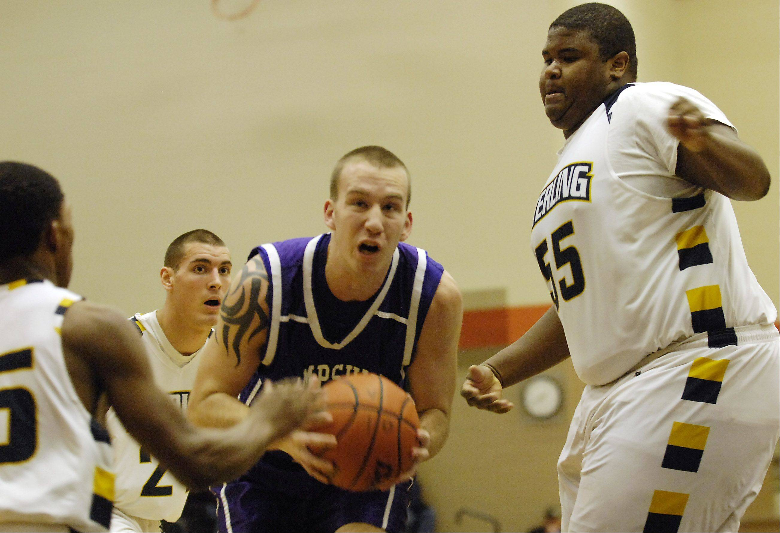 Hampshire's Tyler Watzlawick drives past Sterling's Jordan Neal during their game Wednesday in Dekalb.