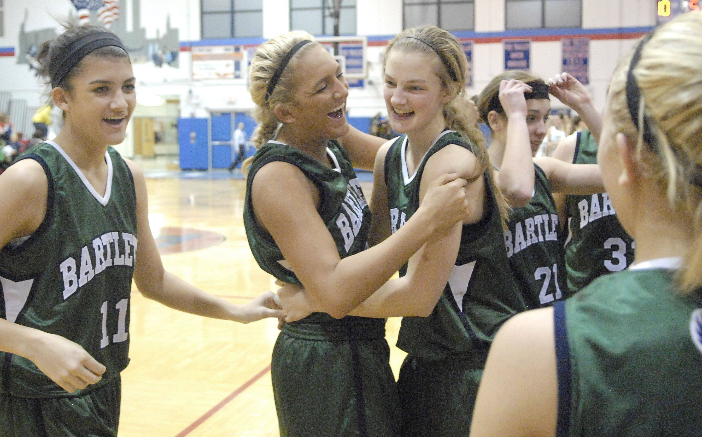 Bartlett's Haley Videckis and Kristin Conniff embrace after taking the championship game over New Trier at the Dundee-Crown Classic on Thursday.