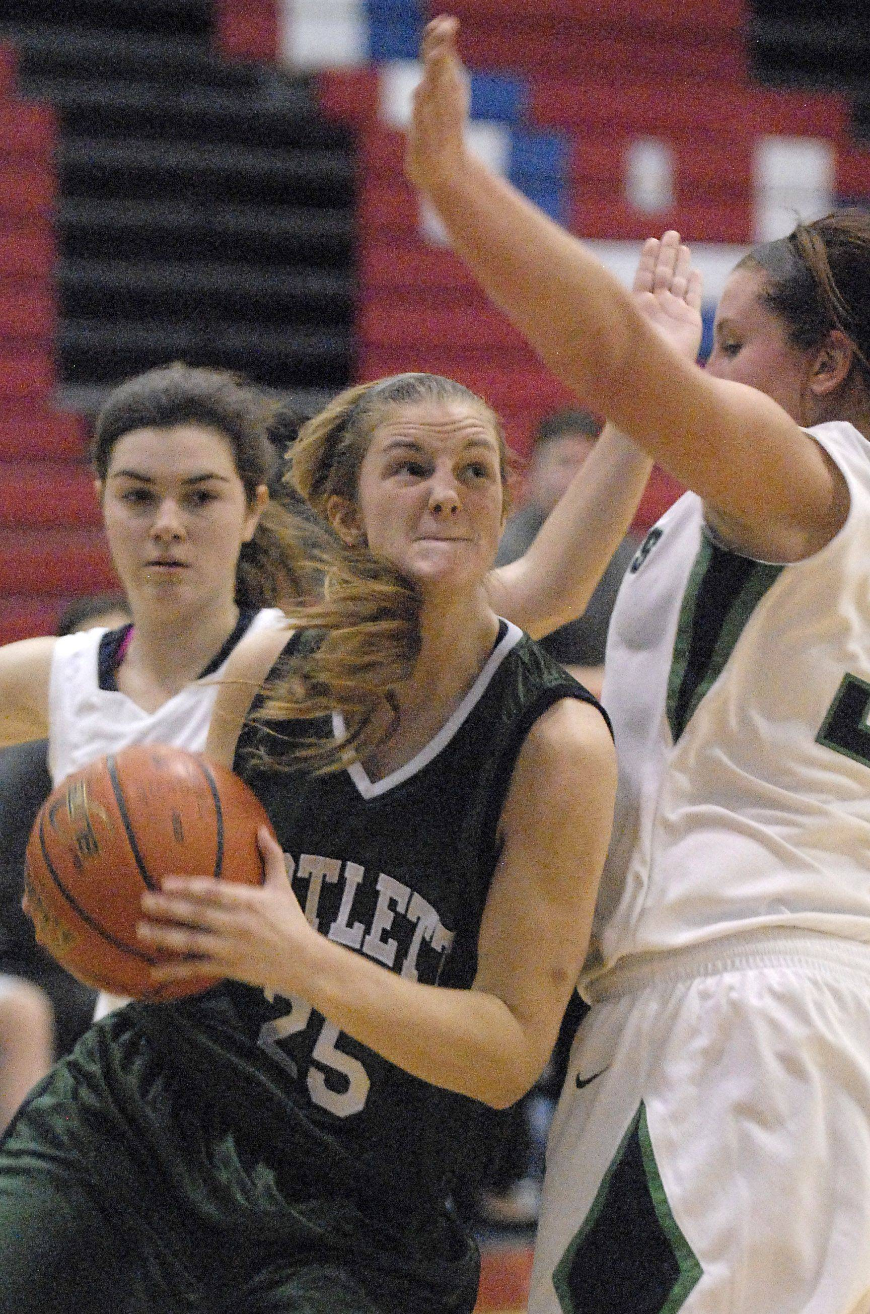 Bartlett's Kristin Conniff pushes around a block by New Trier's Colleen McConnell in the second quarter of the championship game of the Dundee-Crown holiday classic on Thursday, December 29.