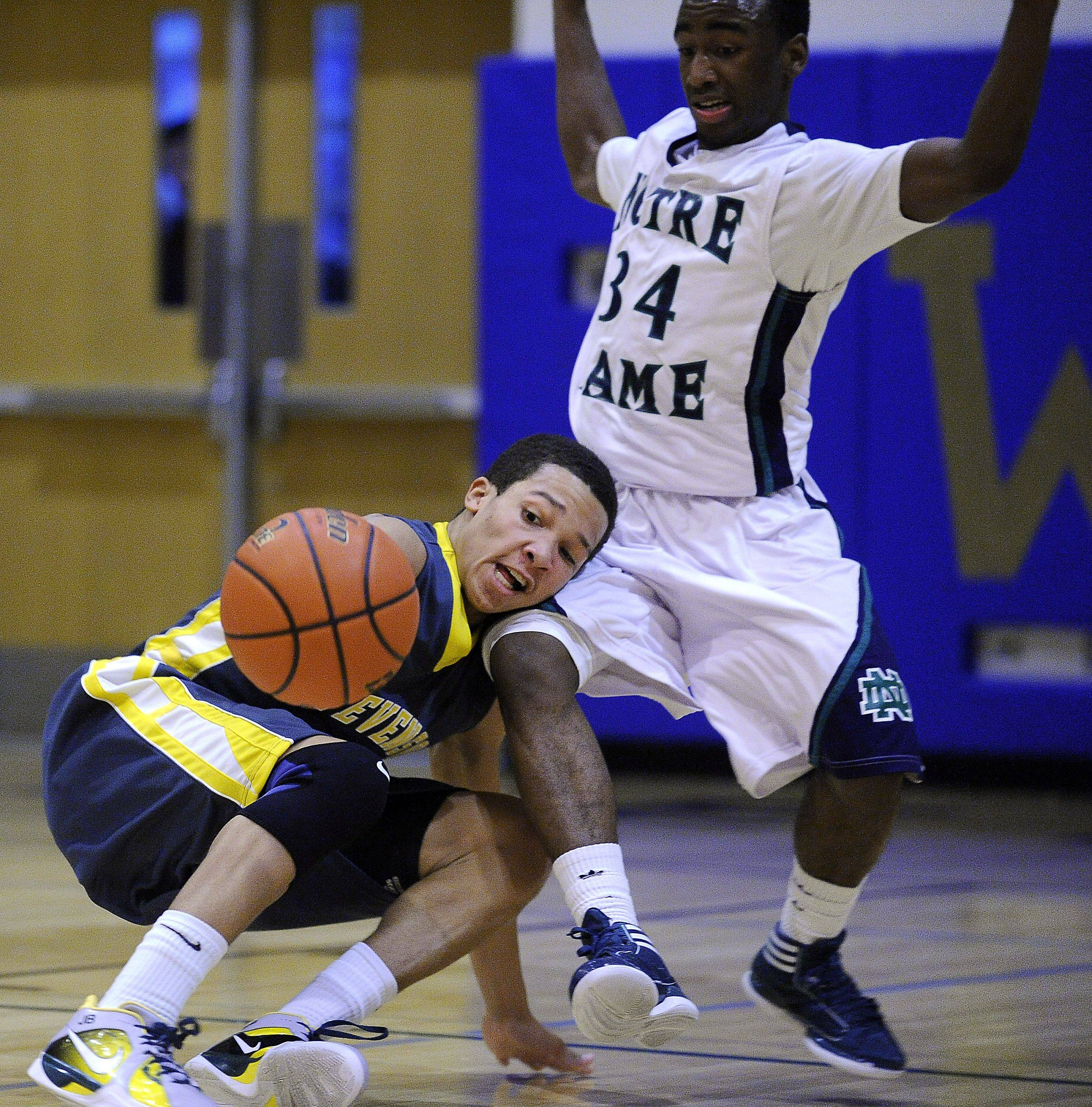 Stevenson's Jalen Brunson collides with Notre Dame's Donte Stephenson in the second quarter and the ball is scooped up by Stephenson in tournament semifinal play Thursday at Wheeling.