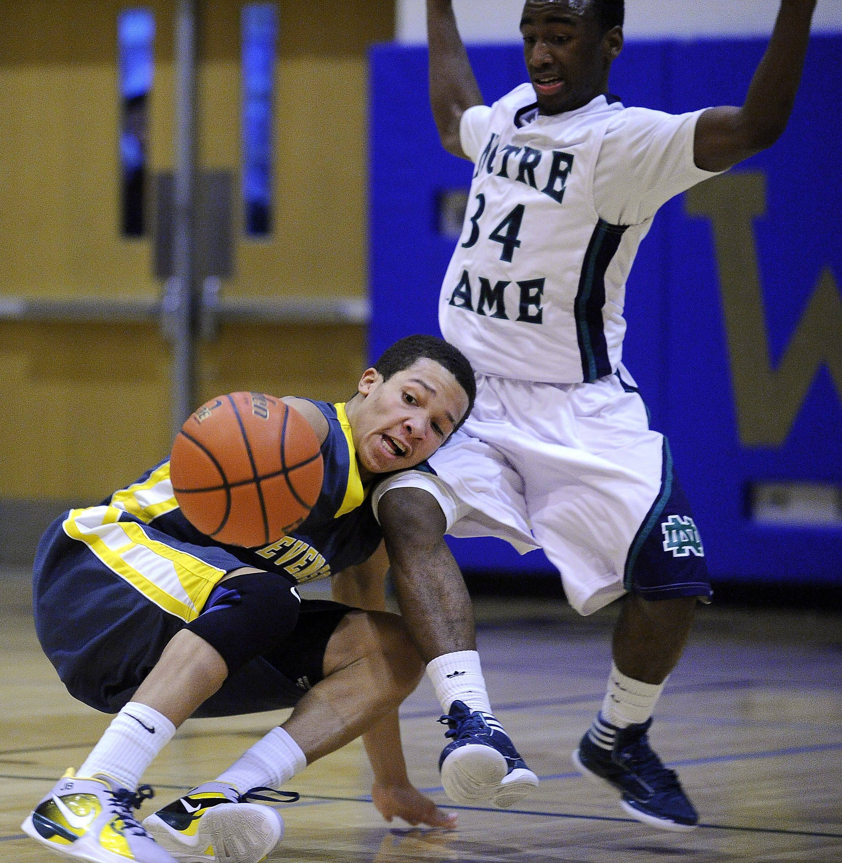 Stevenson's Jalen Brunson collides with Notre Dame's Donte Stephenson in the second quarter and is scooped up by Stephenson for the turnover at the 34th Annual Wheeling Wildcat Hardwood Classic Boys Basketball Tournament at Wheeling High School on Thursday.