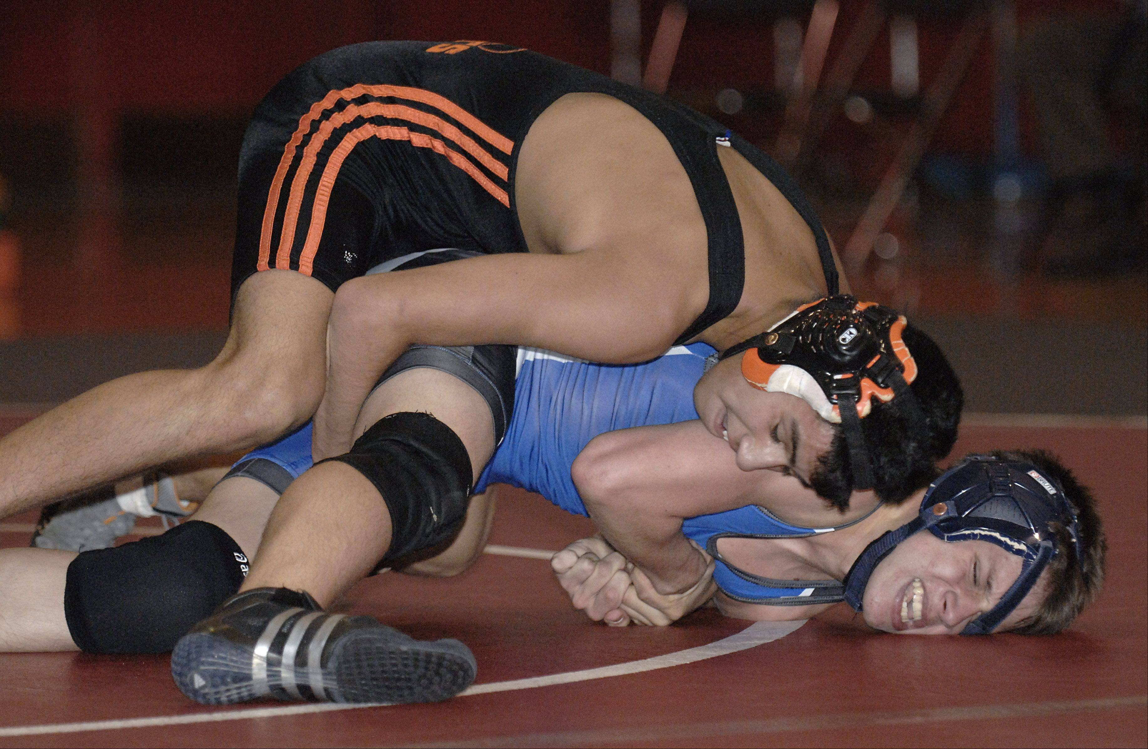 Laura Stoecker/lstoecker@dailyherald.com � St. Charles East's Isaiah Vela takes the 125 match over St. Charles North's Mike Sherry on Wednesday, November 23.