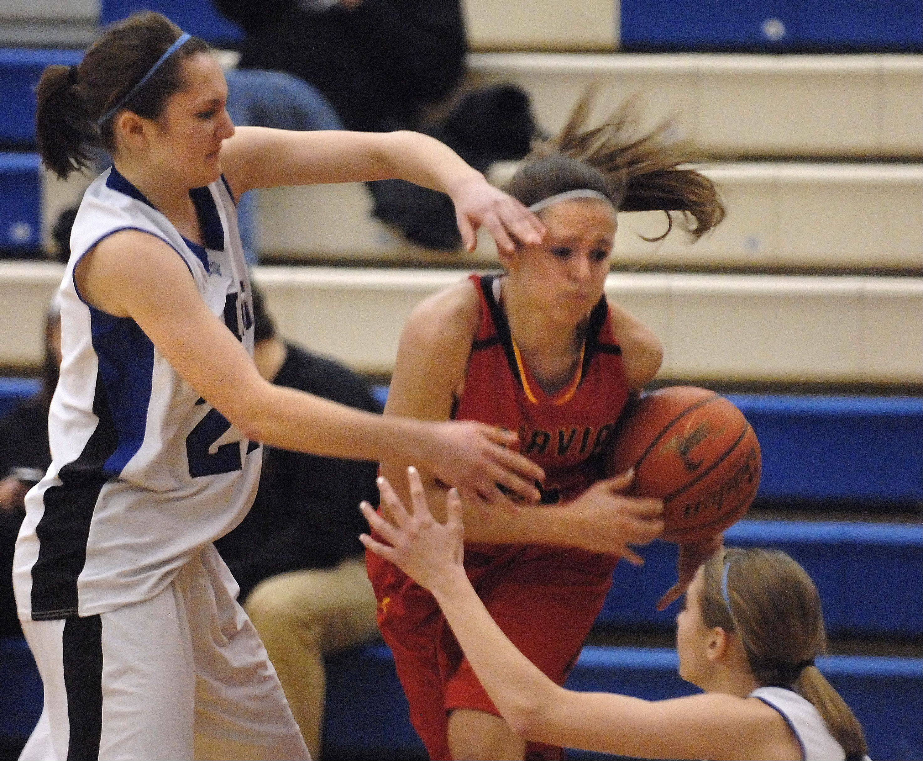 Batavia's Michaela Strehlau is attacked by Geneva's Kelly Sharpe and Stevie Fanale, right.