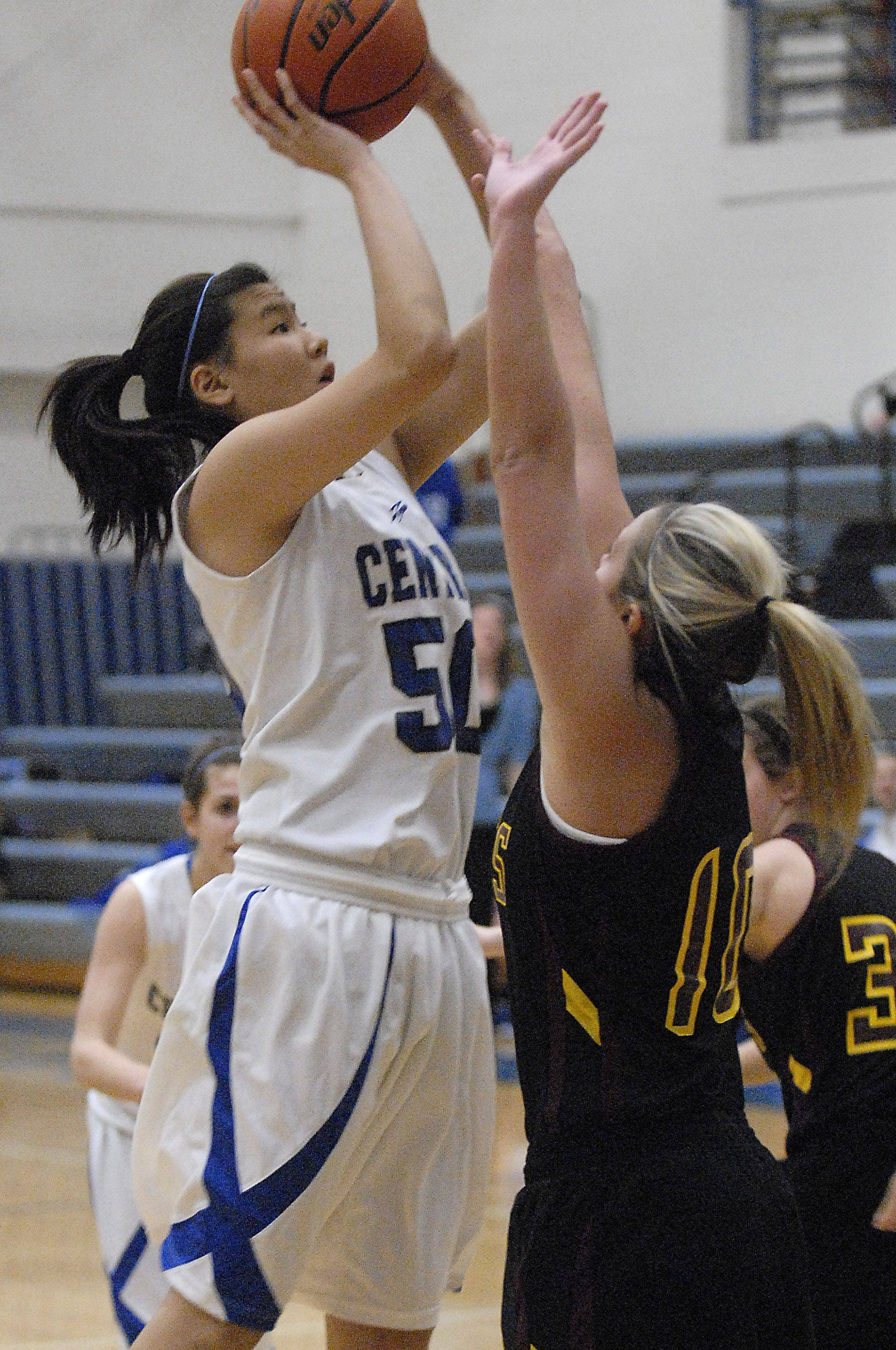Burlington Central's Brenda Thasavong shoots past Richmond-Burton's Alex Callanan in the first quarter on Saturday, January 14.