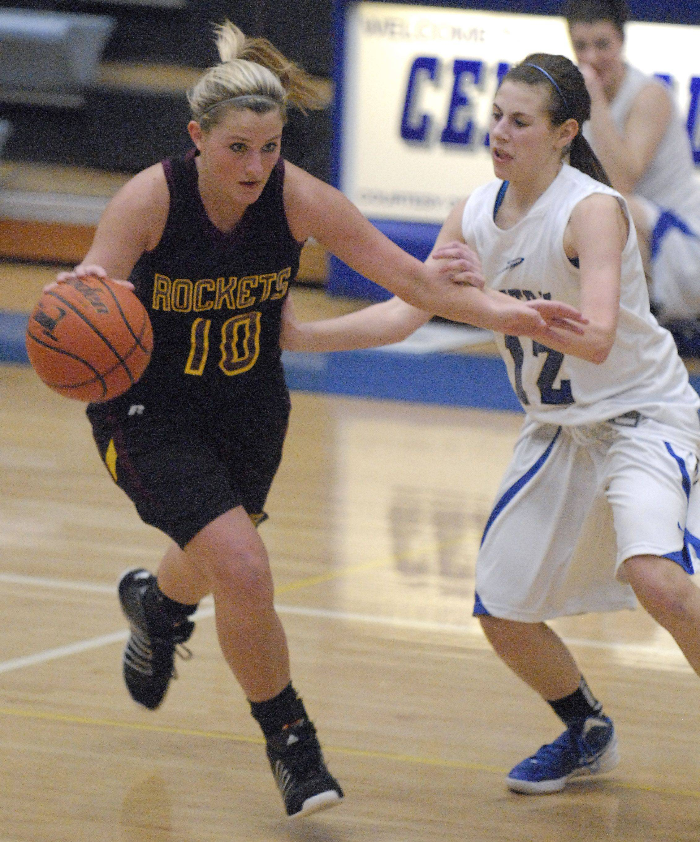 Burlington Central's Catherine Kaynish tries to slow down Richmond-Burton's Alex Callanan in the third quarter on Saturday, January 14.