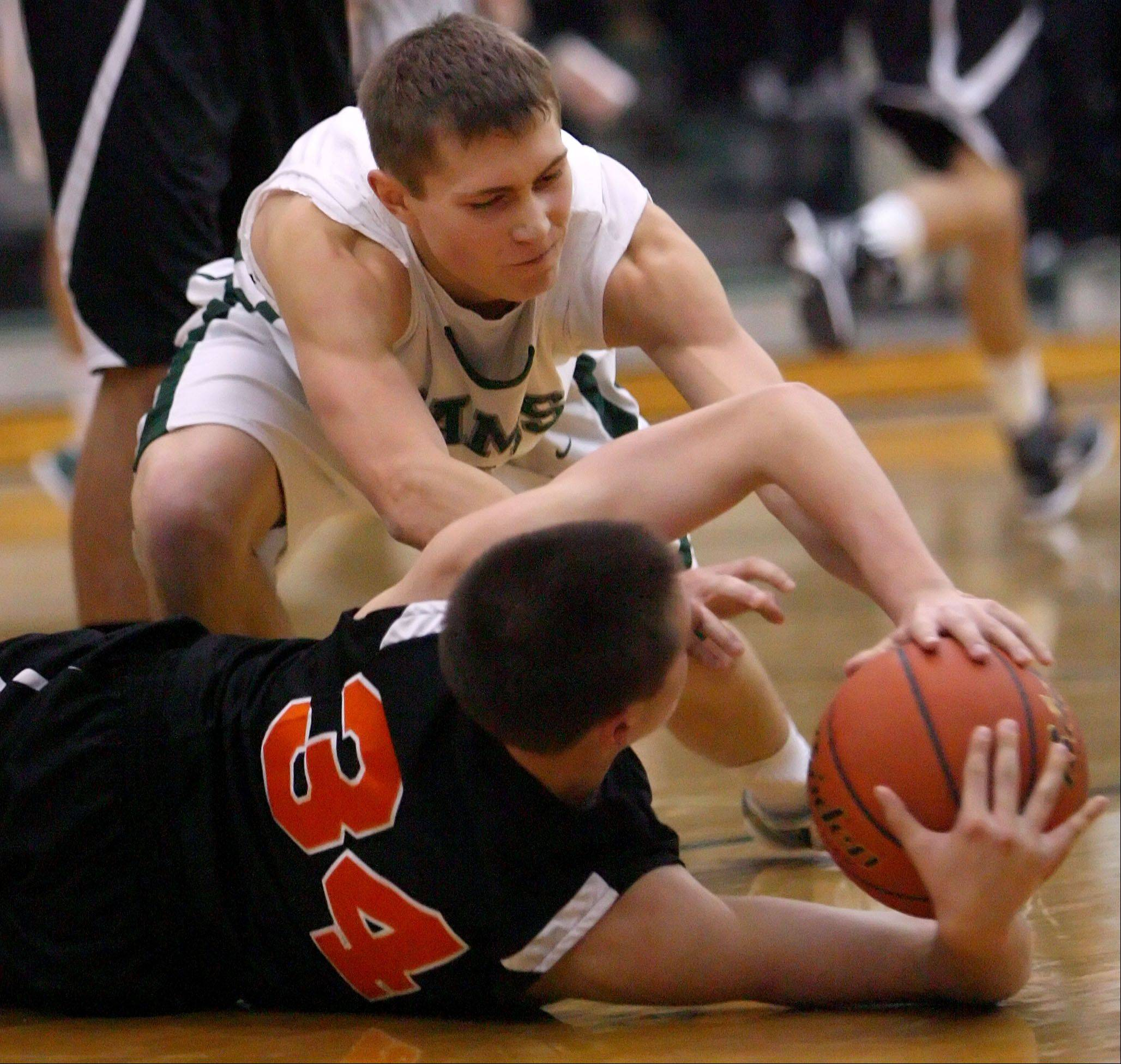 Grayslake Central's Sean Geary and Crystal Lake Central's Jake Vanscoyoc battle for a loose ball Wednesday night at Grayslake Central.