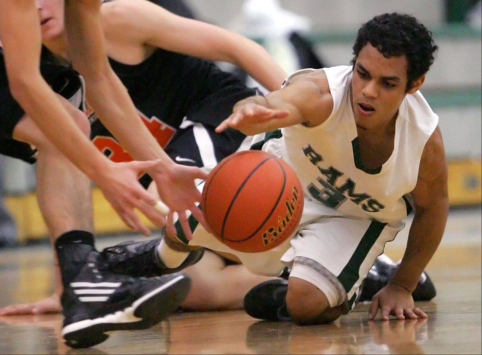 Grayslake Central's Jordan Taylor goes on the floor for a loose ball.