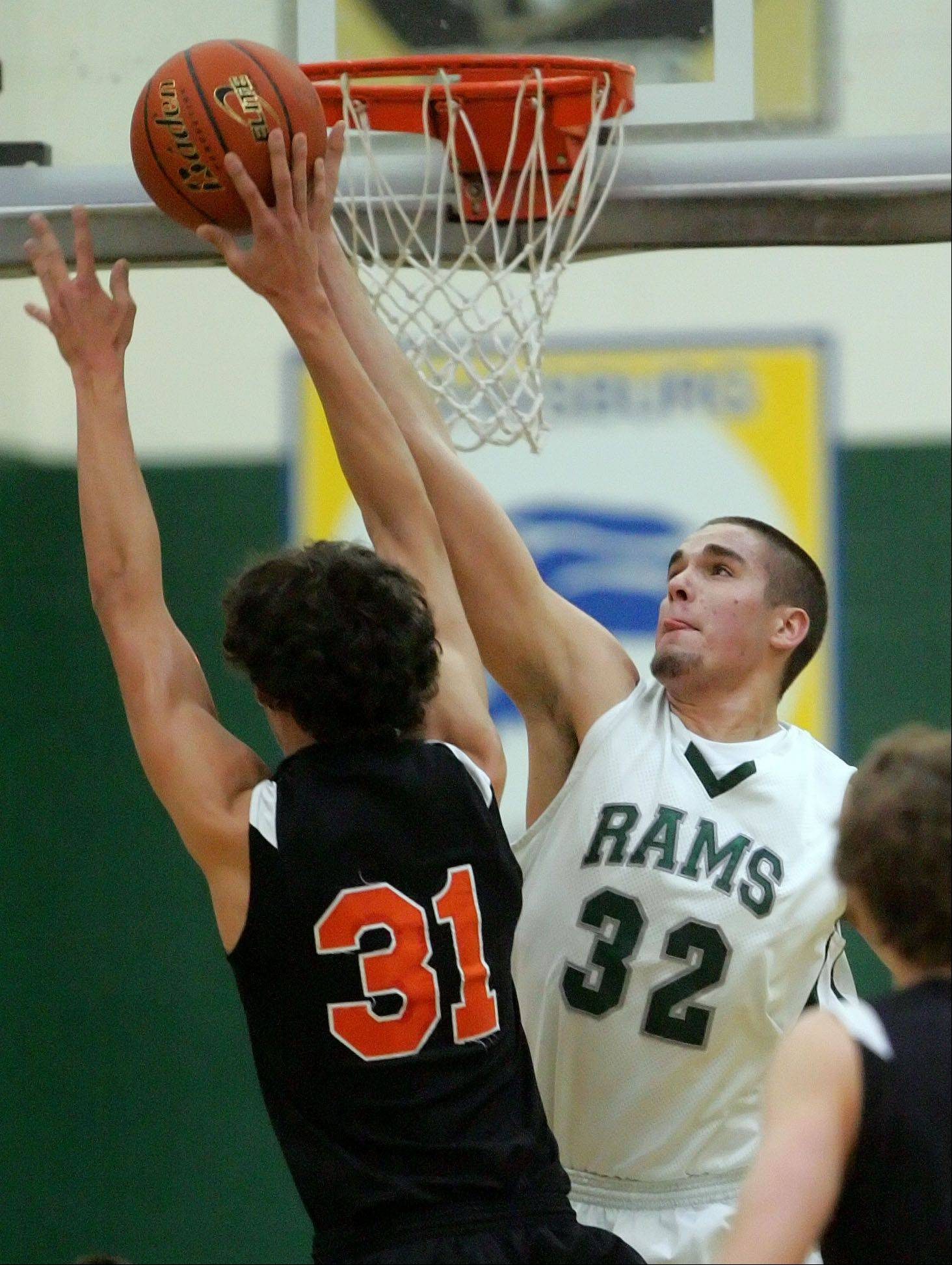 Grayslake Central's Casey Boyle, right, blocks the shot of Crystal Lake Central's Kyle Fleck.